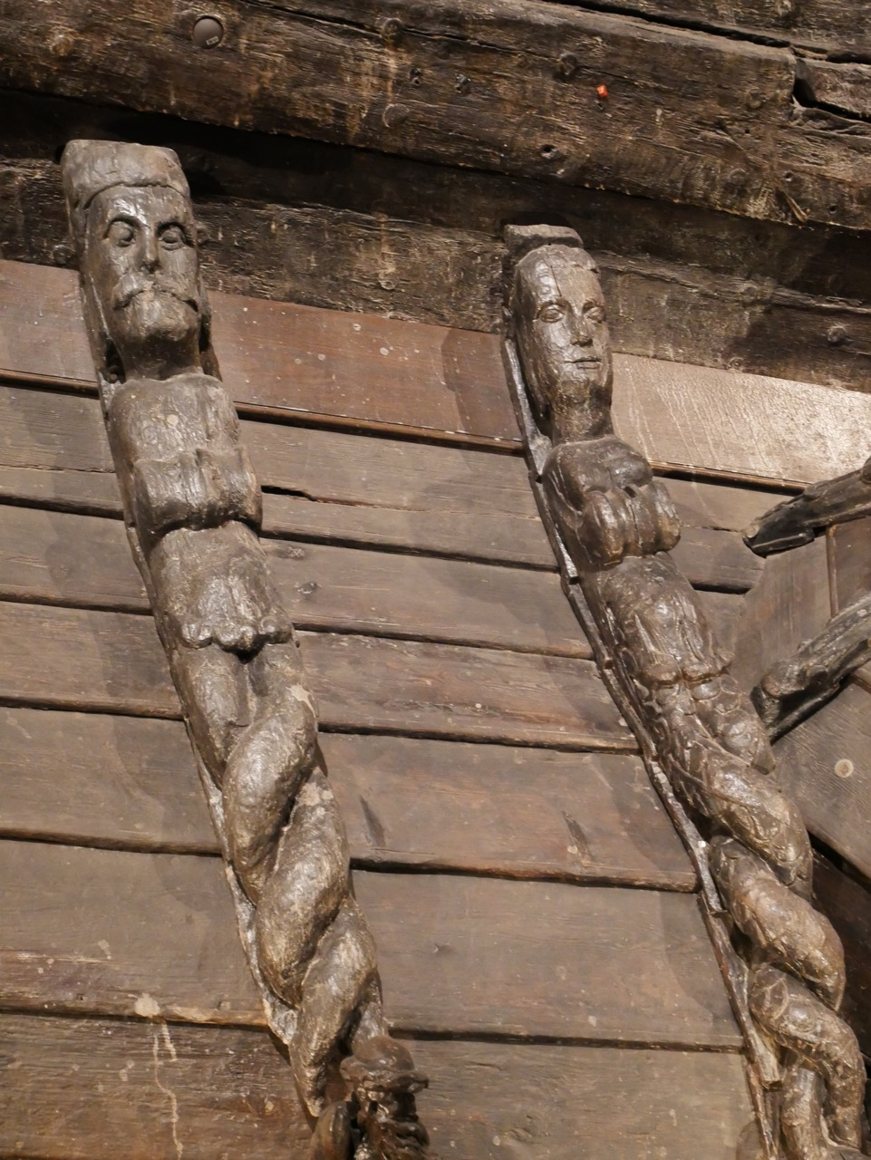 Close up of carved figures from the roof of the exterior room.