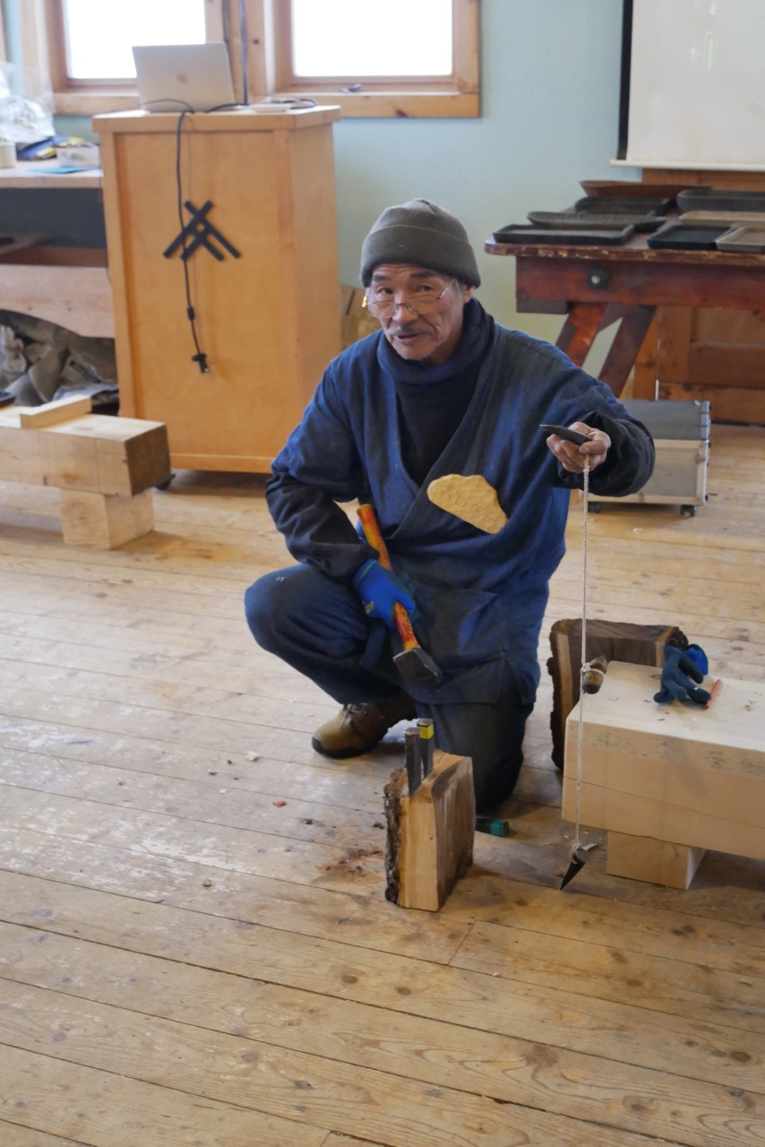 Shinichi Moriguchi demonstrating how to use mini wedges to split the wood into tray blanks.