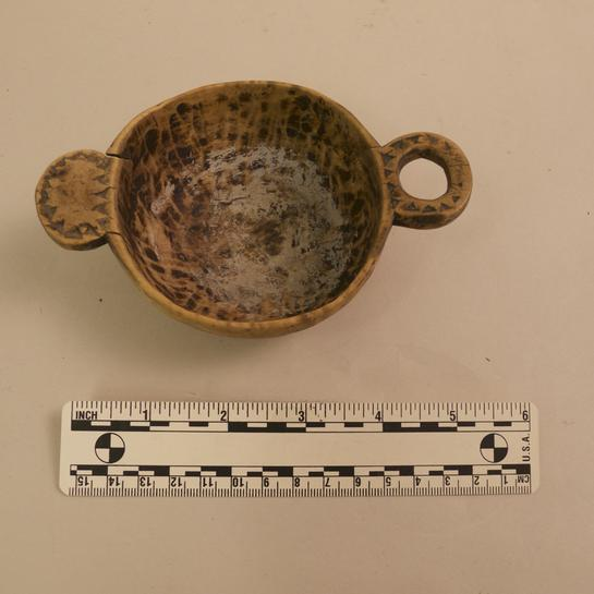 "This is thought to have been an individual dipper for serving ale. 4"" diameter. Date unknown."