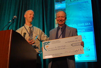 Joe Gaydos awards the Salish Sea Science Prize to John Elliott