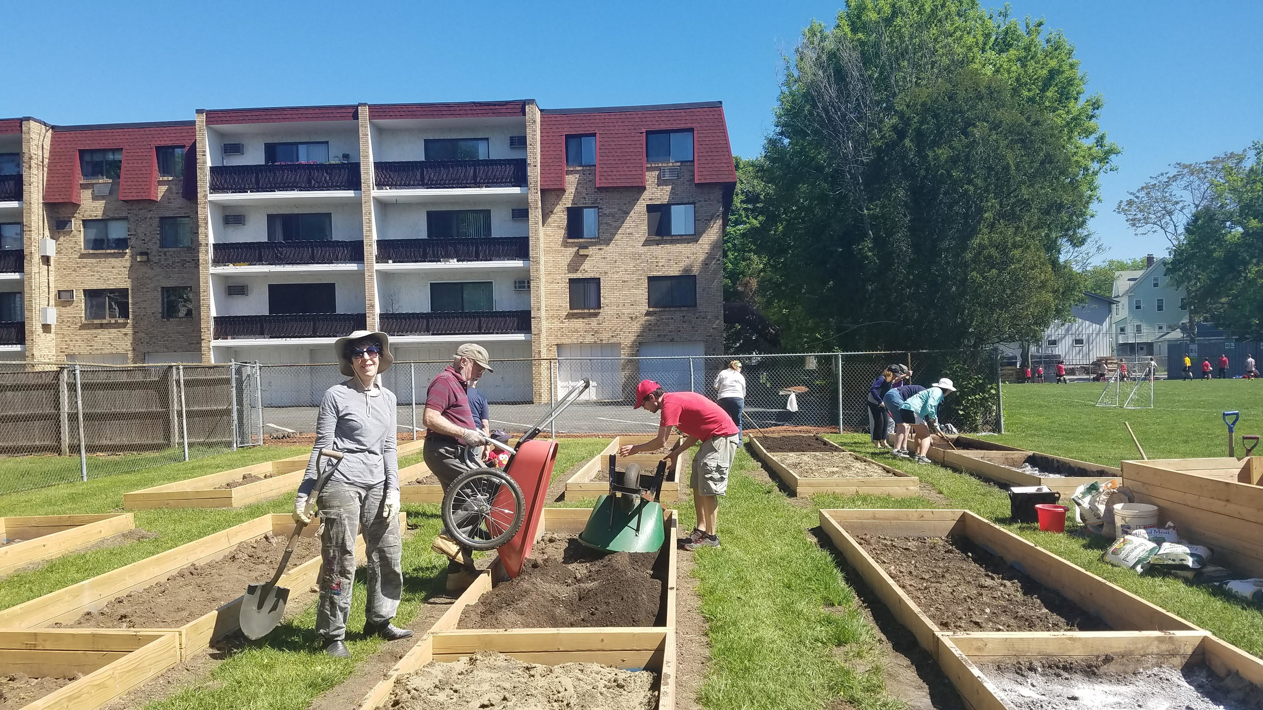 Community Garden - Adding soil to the plots.jpg