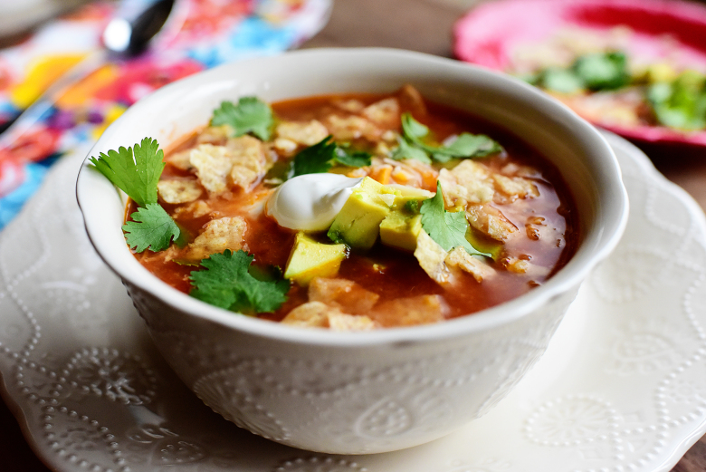 PHOTO BY PIONEER WOMAN  This recipe does require a bit of forethought as it's a slow cooker recipe, but it's Pioneer Woman so you KNOW IT'S GOOD!! Trust us. We all need more tortilla soup in our life!