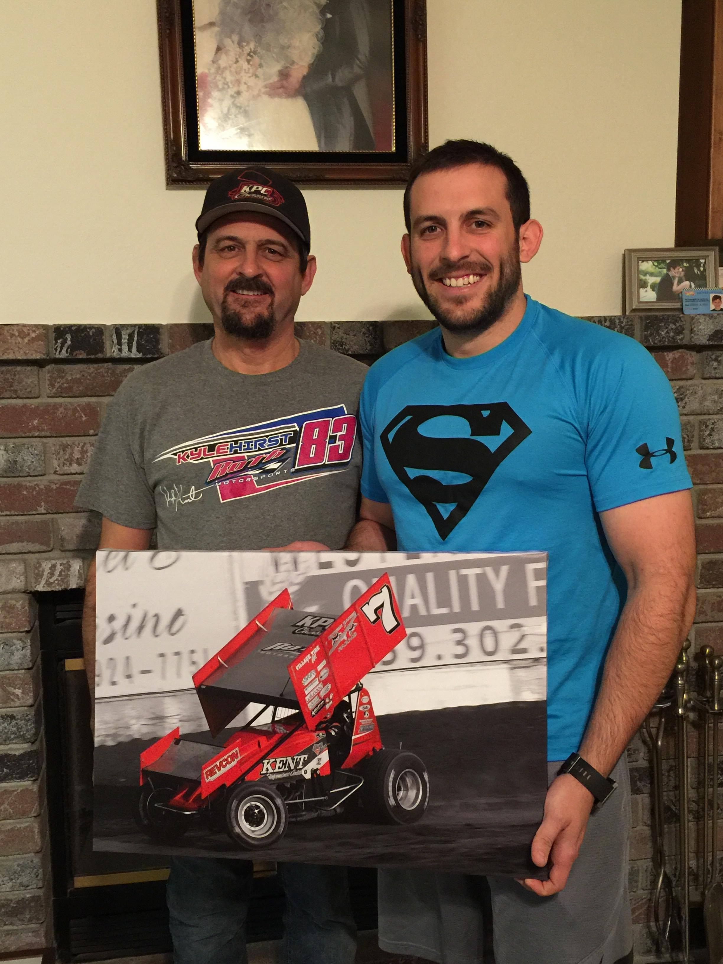 "Steven Kent with his dad Steve holding an 18"" x 24"" Canvas Wrapped Print"