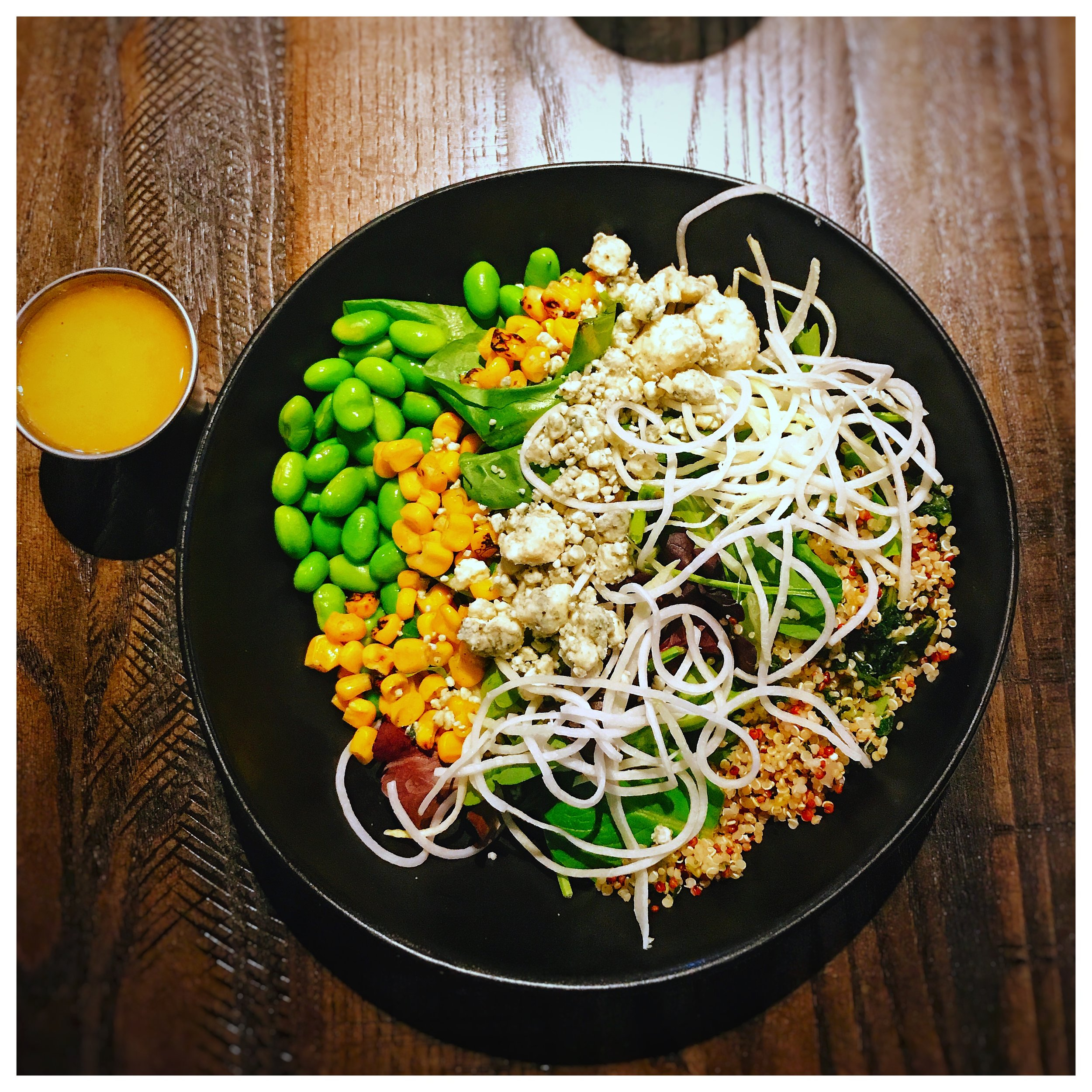 Build Your Own Salad - Duckworth's let us first try their new salad option. Customers can customize their salad now, but for us they went ahead and prepared a delicious combination of quinoa, kohlrabi, edamame, bleu cheese crumbles, corn, and hearts & hearts served with a champagne vinaigrette. The presentation was beautiful and very colorful. All of the ingredients tasted fresh and it was a good way to start out the meal. The vinaigrette also pared really well with this salad and was balanced. Customers can definitely look forward to the new build your own salad options.