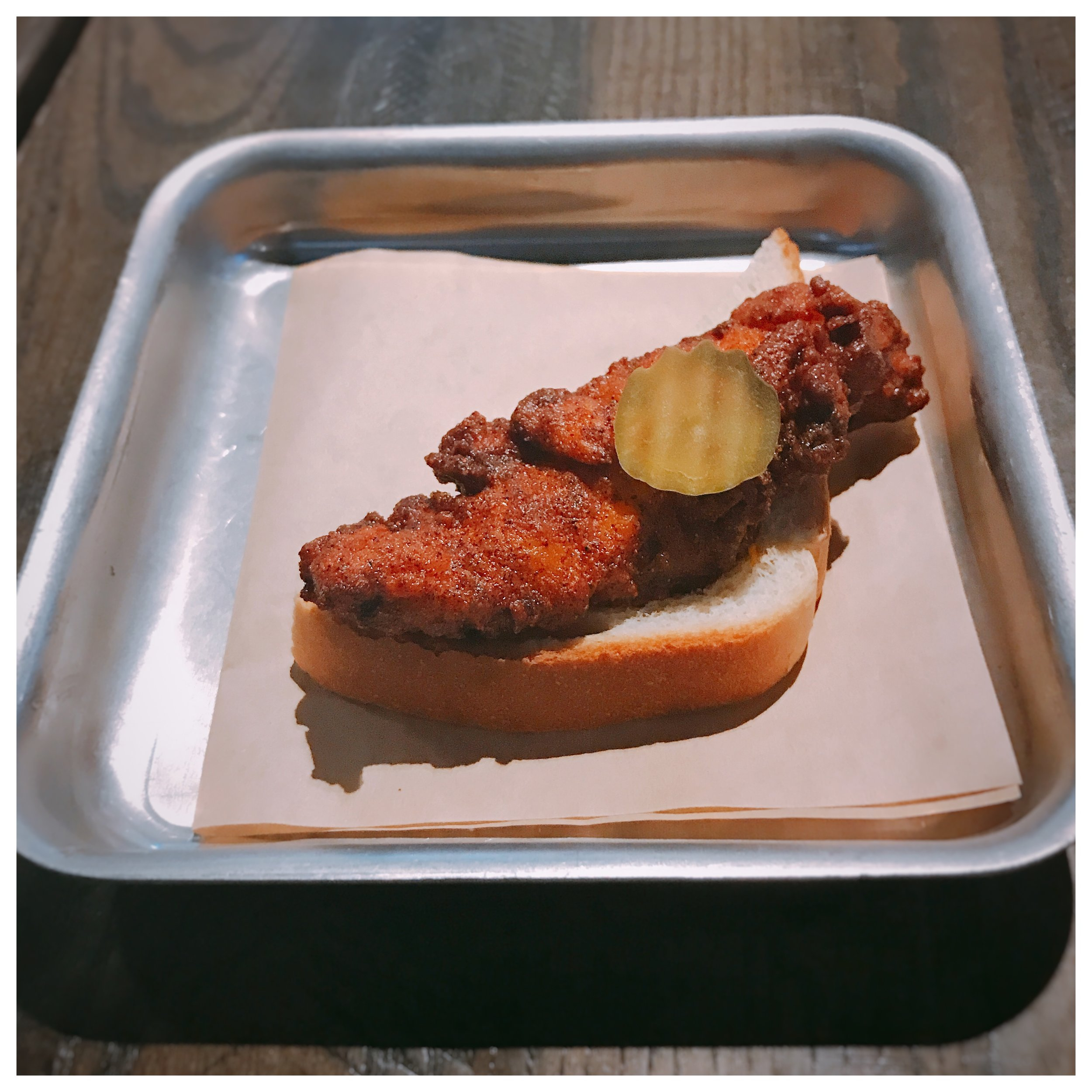 Nashville Hot Chicken - So this was my first time having Nashville Hot Chicken and I feel like I've been missing out! I can't compare it to Hot Chicken in Nashville or any other place since this was my first taste of the dish, but it was tasty. I'm a fan, and you like your chicken with a some 'kick', you will be also. I thought the flavor here was great, and the heat came through really well at the end of each bite. Many dishes that are marketed as spicy aren't, but I can say I did get a bit of spice here which was nice. It's not overly, mouth on fire spicy, but for me it had the right balance. I'll be going back to get the fully sandwich!