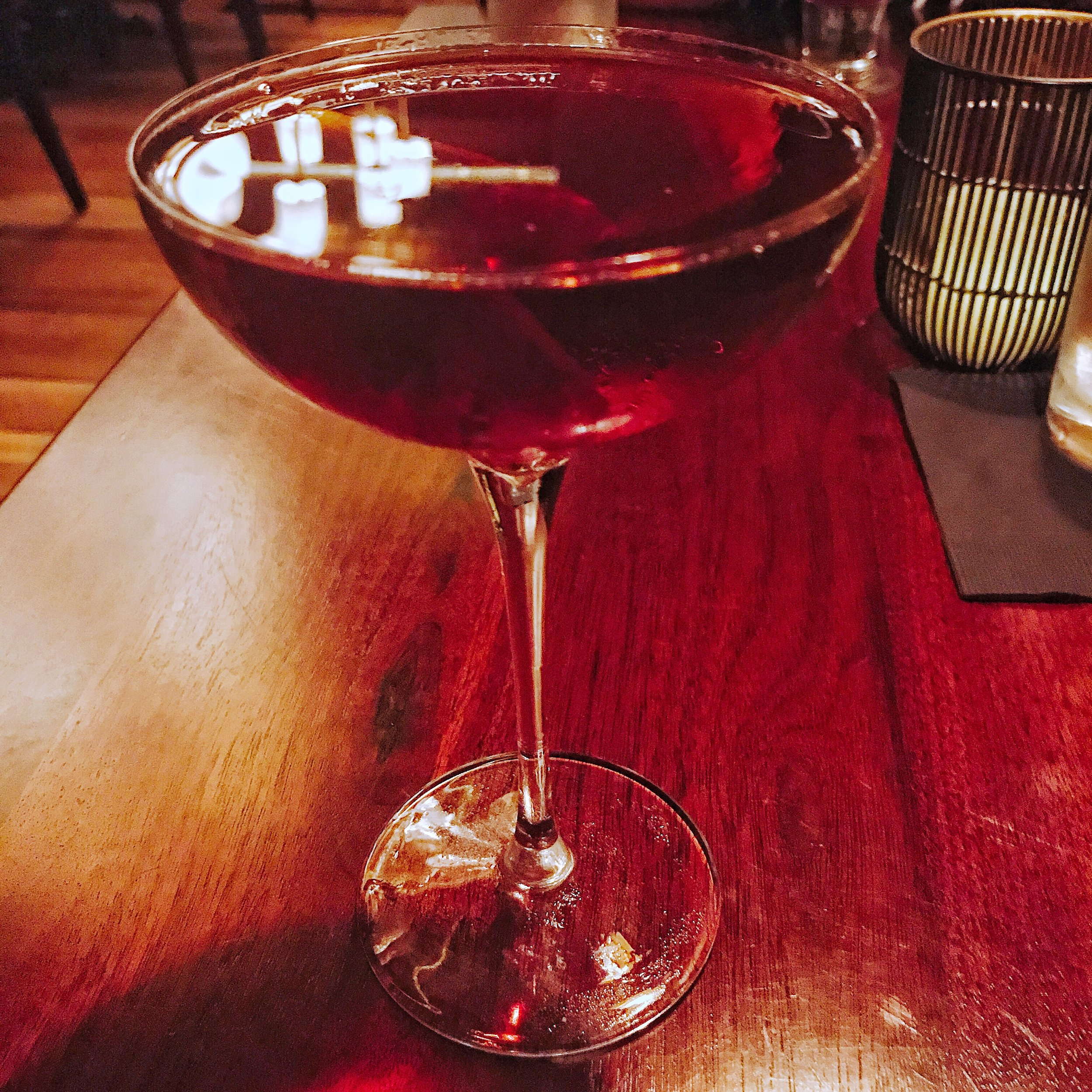 The Richardson - Henry McKenna 10 year bourbon, Pedro Ximenez sherry, Amaro Montenegro, Drambuie, Peychaud's bitters, served up. I really enjoyed this drink. It's very similar to a really good old fashioned, except the bourbon was not masked here and really came through well.