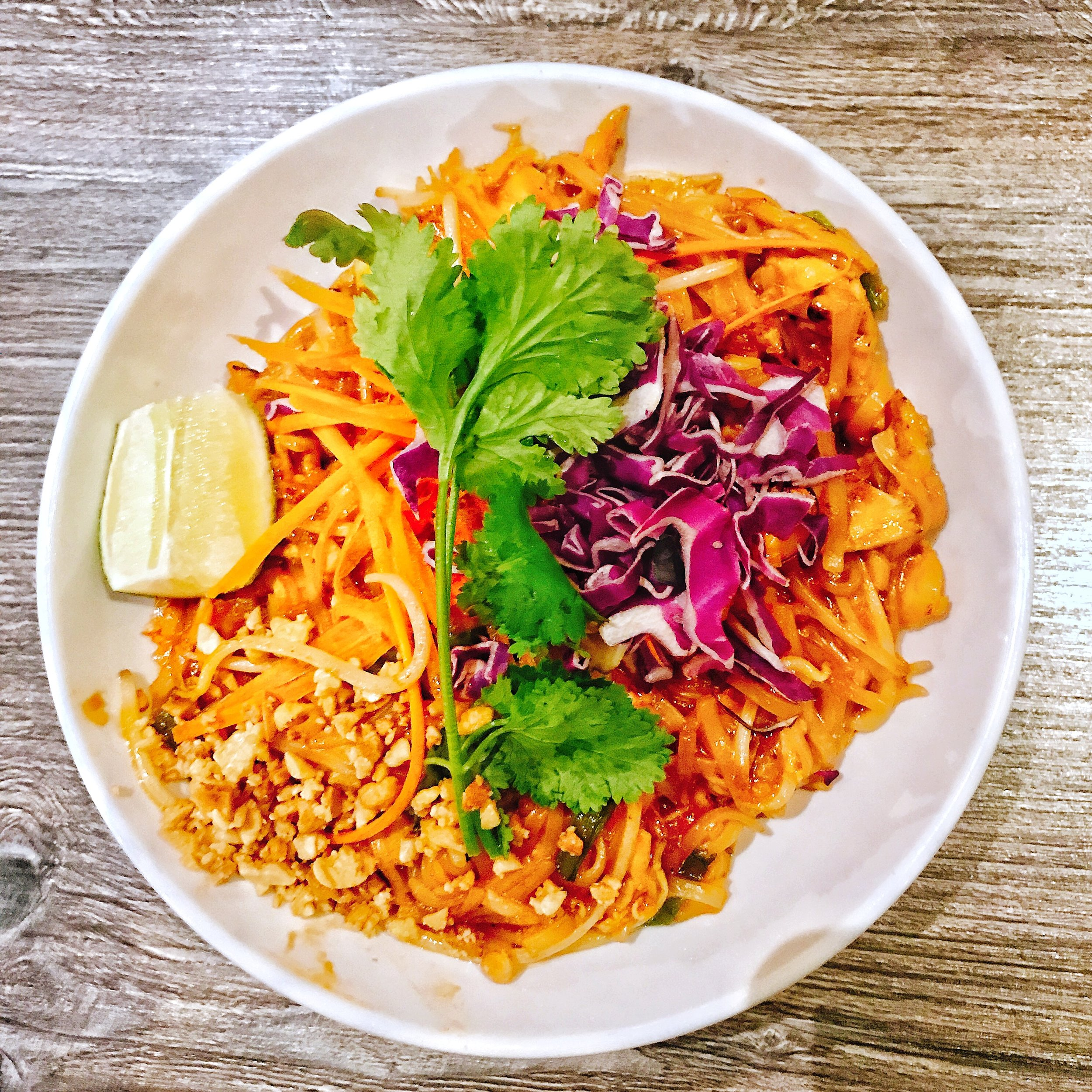 Pad Thai - Of course I had to get Pad Thai! I went with chicken, but they have options for tofu or shrimp as well. This was THE BEST Pad Thai I've had so far in Charlotte! So much so, that I ate way to much of it and then was too full to try their other items, ha! This dish features thin rice noodles with tamarind sauce, serve with bean sprouts, lime wedge, peanuts, and cilantro. Each bite is a flavor bomb. Well done!