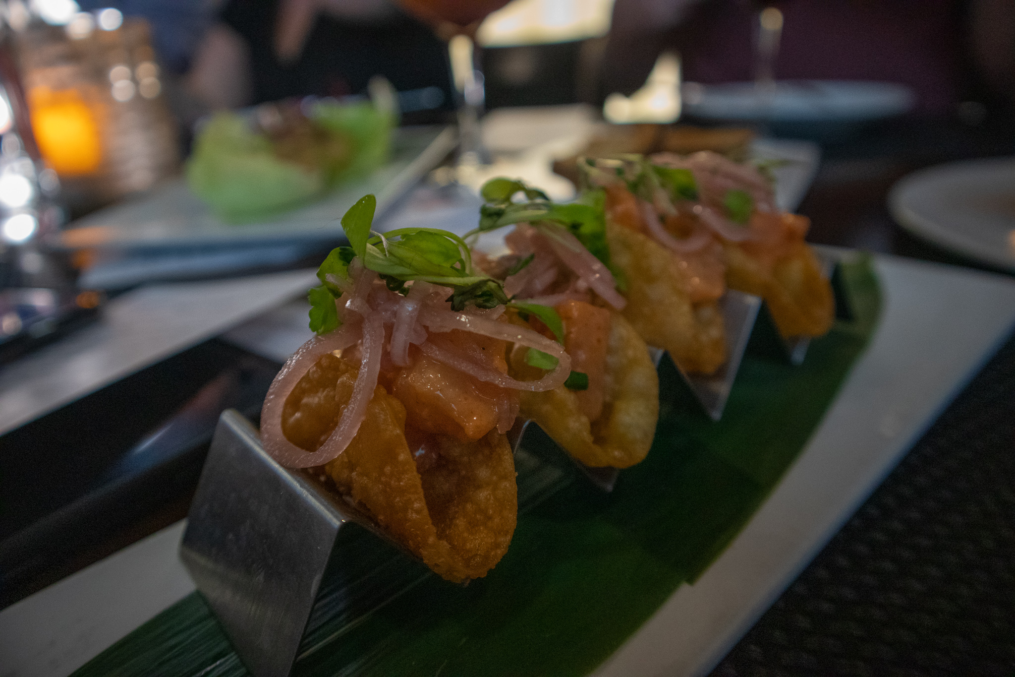 Spicy Yellowtail Wonton Tacos - Yellowtail, Chili Oil, Pickled Shallots, Green Onions, Cilantro