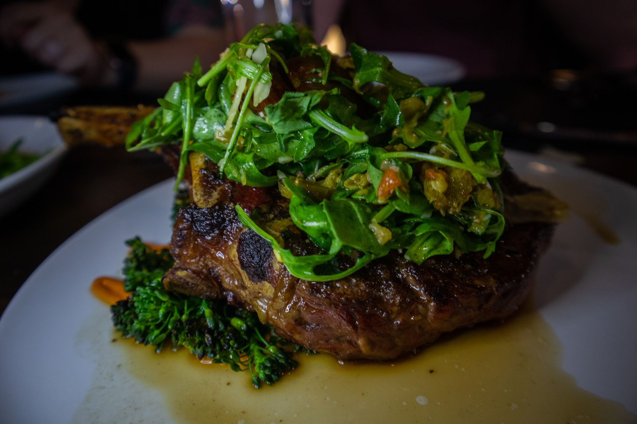 22 oz Bone-in Ribeye - Grilled Broccoli, Arugula, Shishito Pepper Salsa