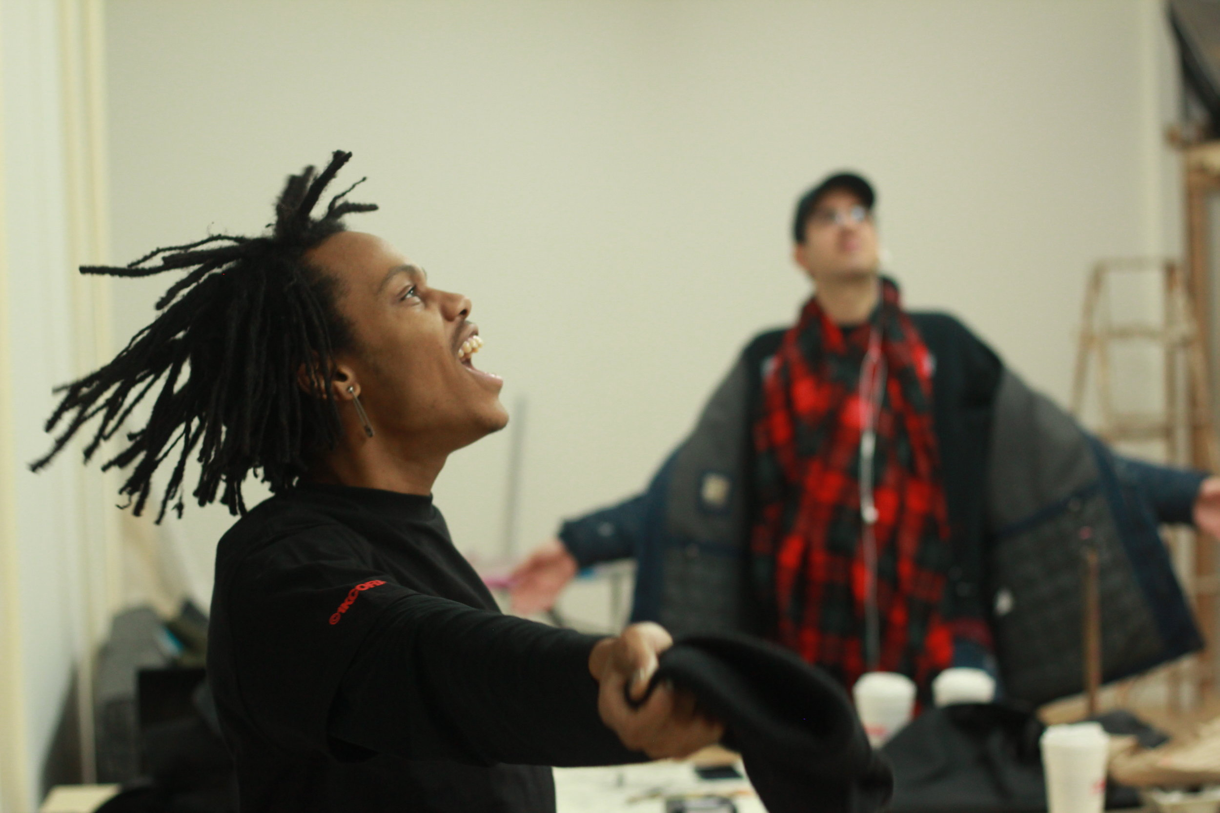 Casper and Demetrious take a dance break in the first month of building our permanent space