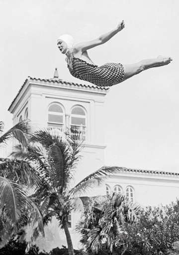 Photo of woman diving into the pool at The Surf Club