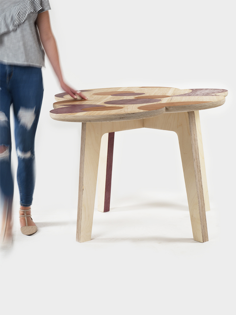 Together they designed and handcrafted this table. - Materials: Plywood, Hickory, Purple Heart and Jarrah veneer