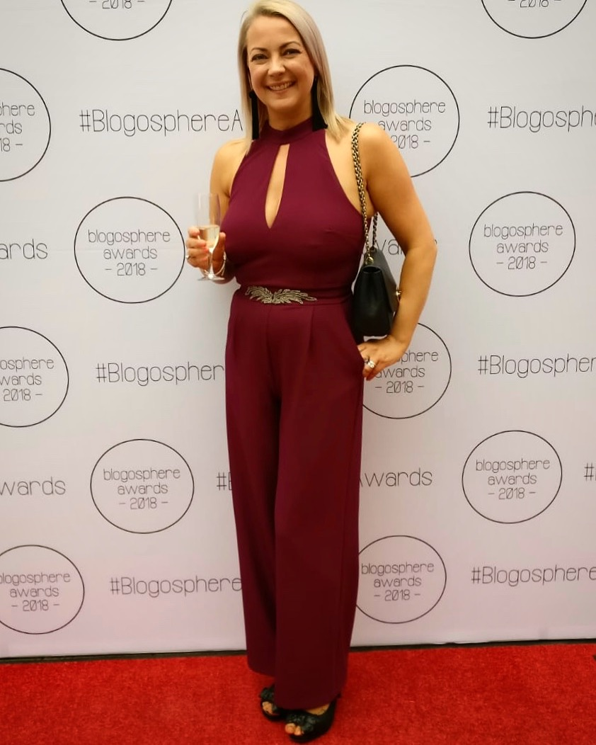 Me. On an actual red carpet. Holding a glass of fizz instead of a cup of coffee shocker.