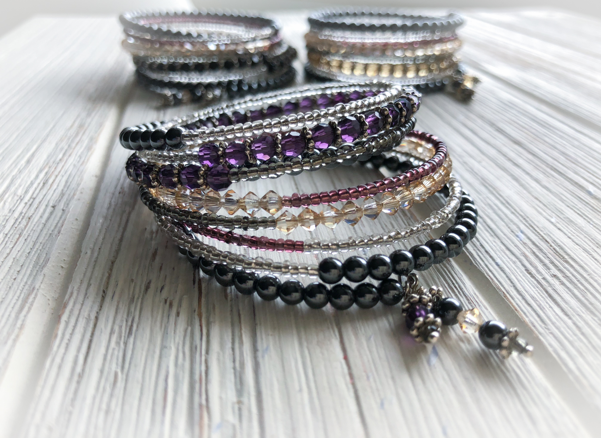 Memory Wire Bracelet   Mixed crystals and hematite beads wrap bracelet with one prominent color. Available in Navy, Red, Purple, Champagne and Black. Wraps 8 times.  To Purchase  email 88Jewels Ltd.  Please Include the name of item and color preference.