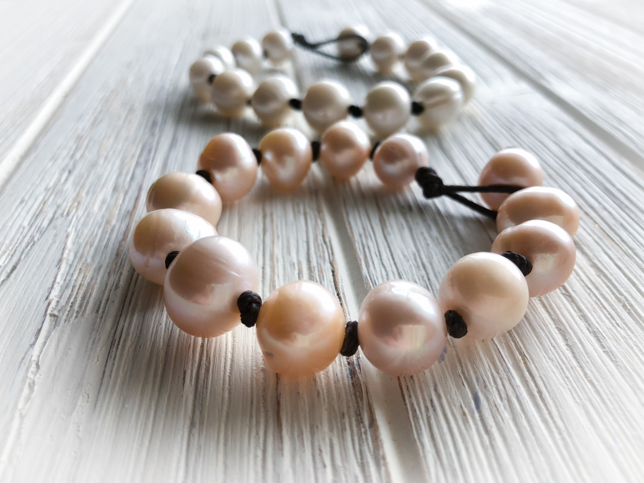 Pearl Bracelet   7 inch single cord knotted pearls available in blush or white.  To Purchase  email 88Jewels Ltd.  Please Include the name of item and color preference.