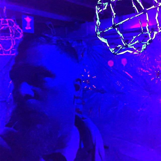 Preambulating under black lights.