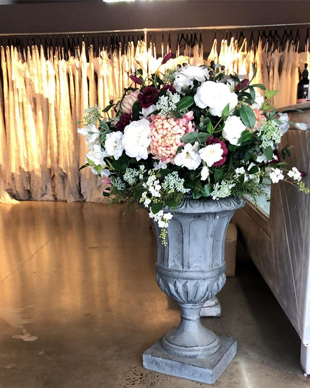 One of our beautiful flower urns, on display at @luvbridal Maroochydore 💕 . #artificialweddingflowers #sunshinecoastweddingflorist #weddingflorist