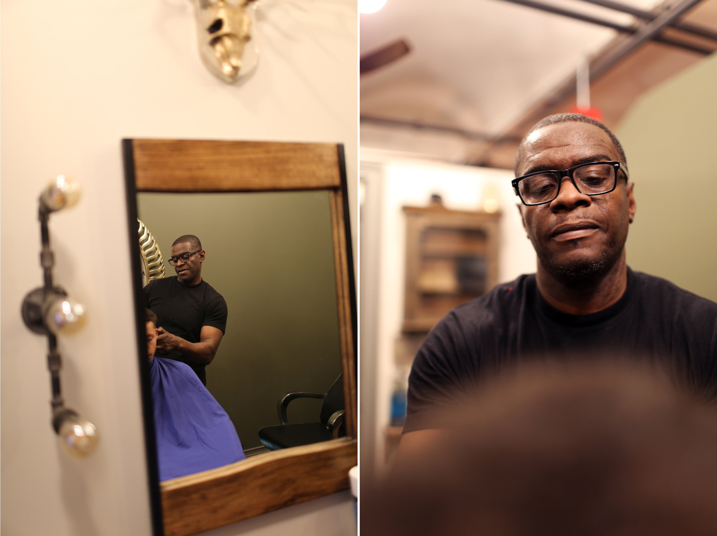 Mark Denny poses at his barbershop in Brooklyn. He was recently exonerated after being convicted at 17. Photo by Kunjo.