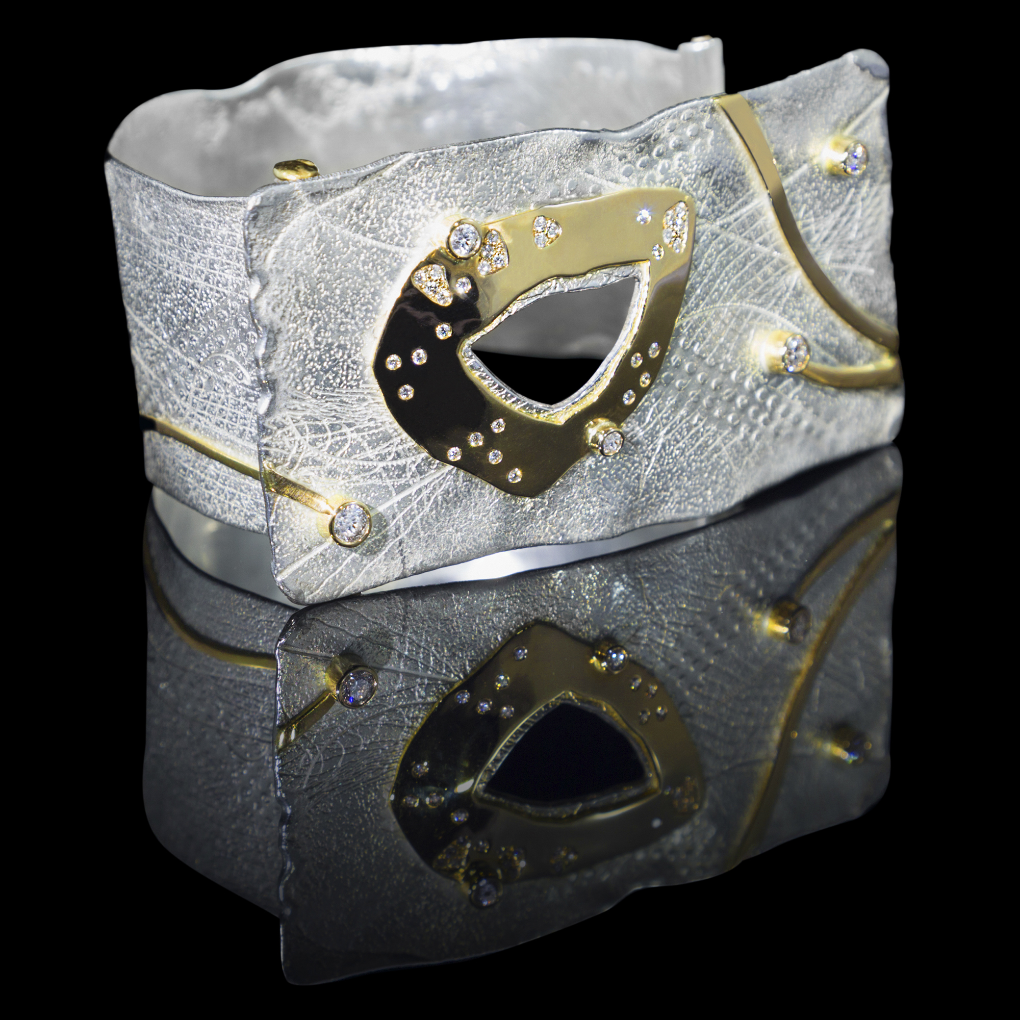FRIDA | Fine Jewellery. Shield™ Collection, Shackle cuff. Symbolizing women empowerment. Custom designed sterling silver and 18kt yellow gold cuff set with brilliant-cut diamonds.