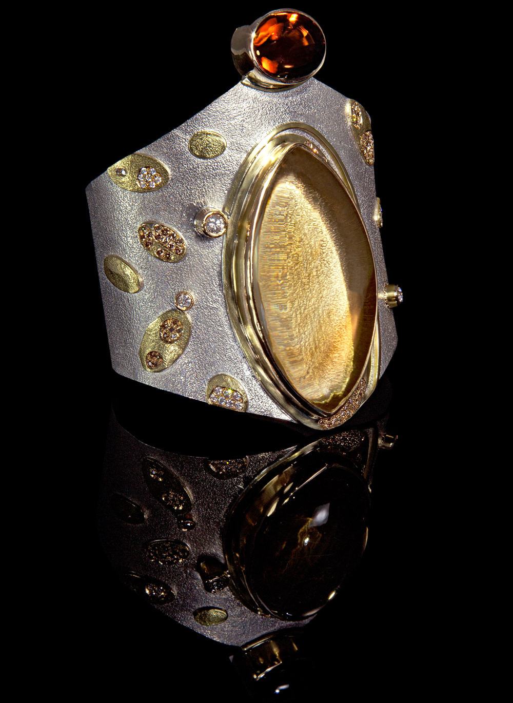 FRIDA. As Seen in British Vogue. Shield, Amira cuff.