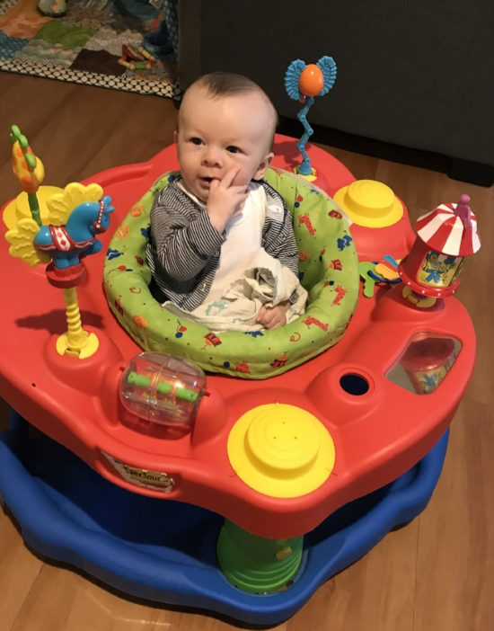 Lovin' his exersaucer!