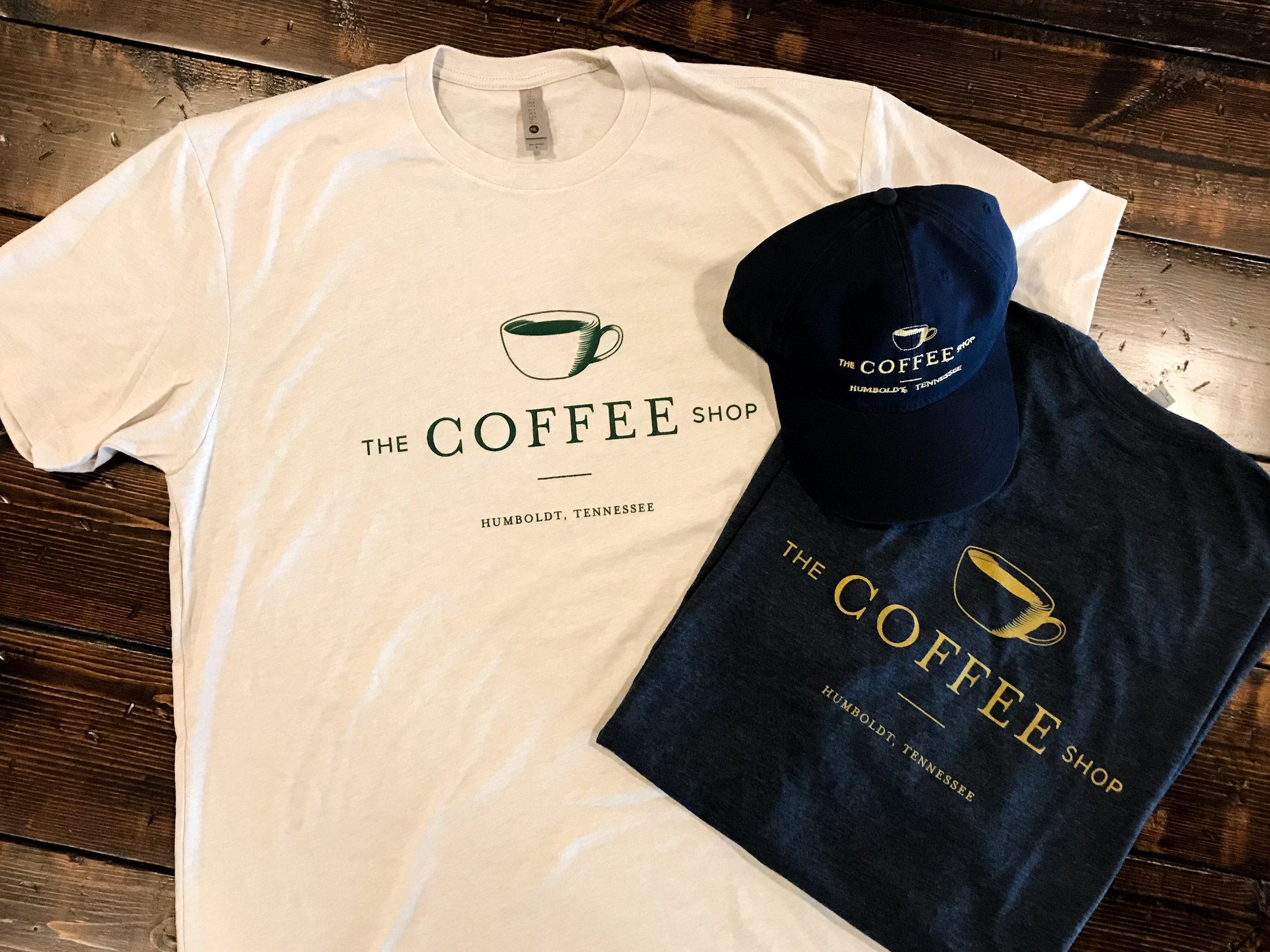 Coffee Shop Merchandise - Hats: $14T-shirts: SM-XL $16, XXL^ $20Coffee Shop Bundle: $27