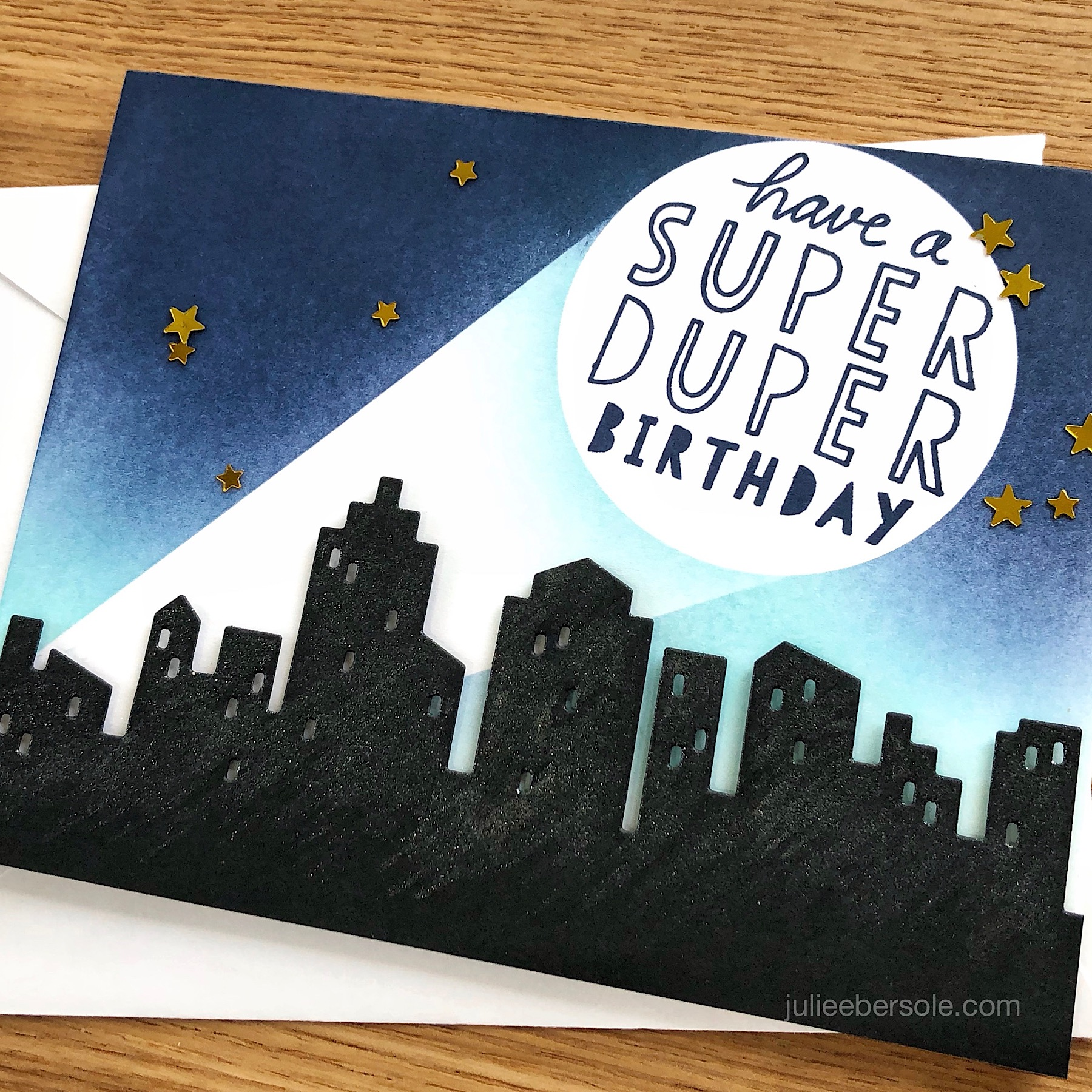 DESIGN NOTE:  Shimmer Pen  was brushed over the  Big City die cut  after it was mounted to the card front.