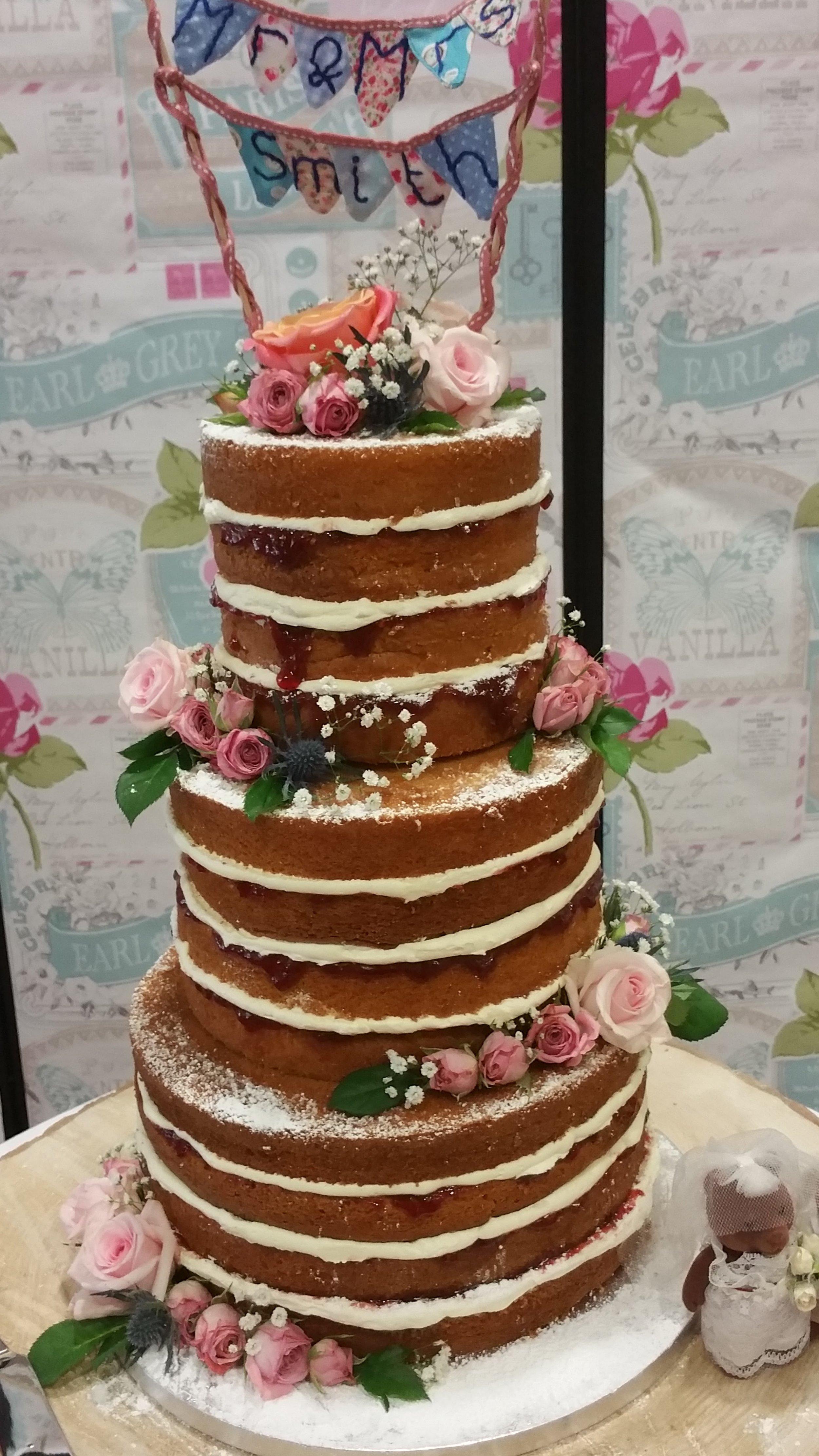 Naked sponge cake - Scrumpious 3 tier, 4 layer, Madagascan vanilla sponge cake with strawberry jam and whipped vanilla buttercream.