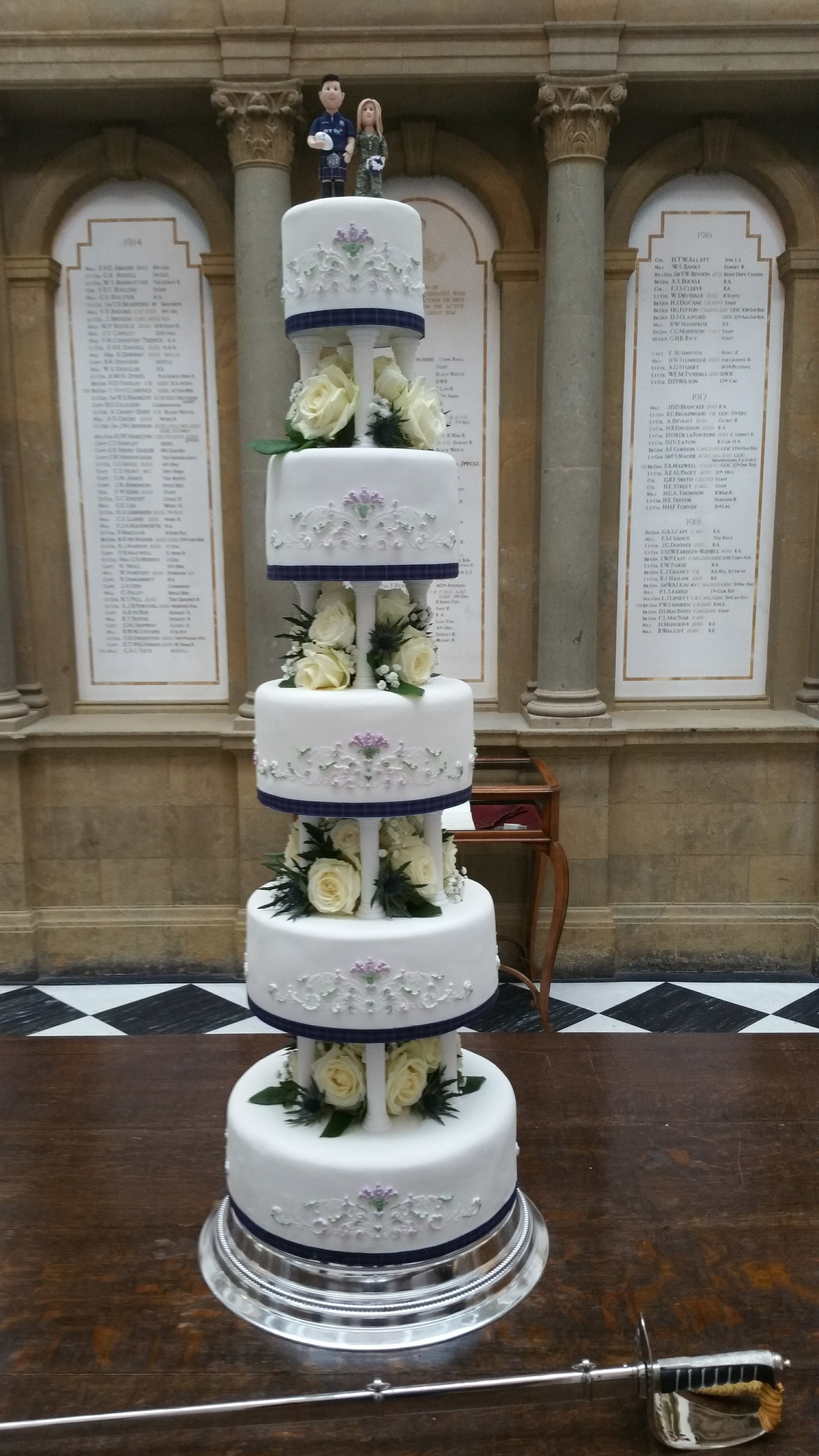 Traditional wedding cake - Fabulous 5 tier pillared, double height, traditional wedding cake. This wonderful cake was decorated with fresh flowers and featured hand piped royal icing designs.