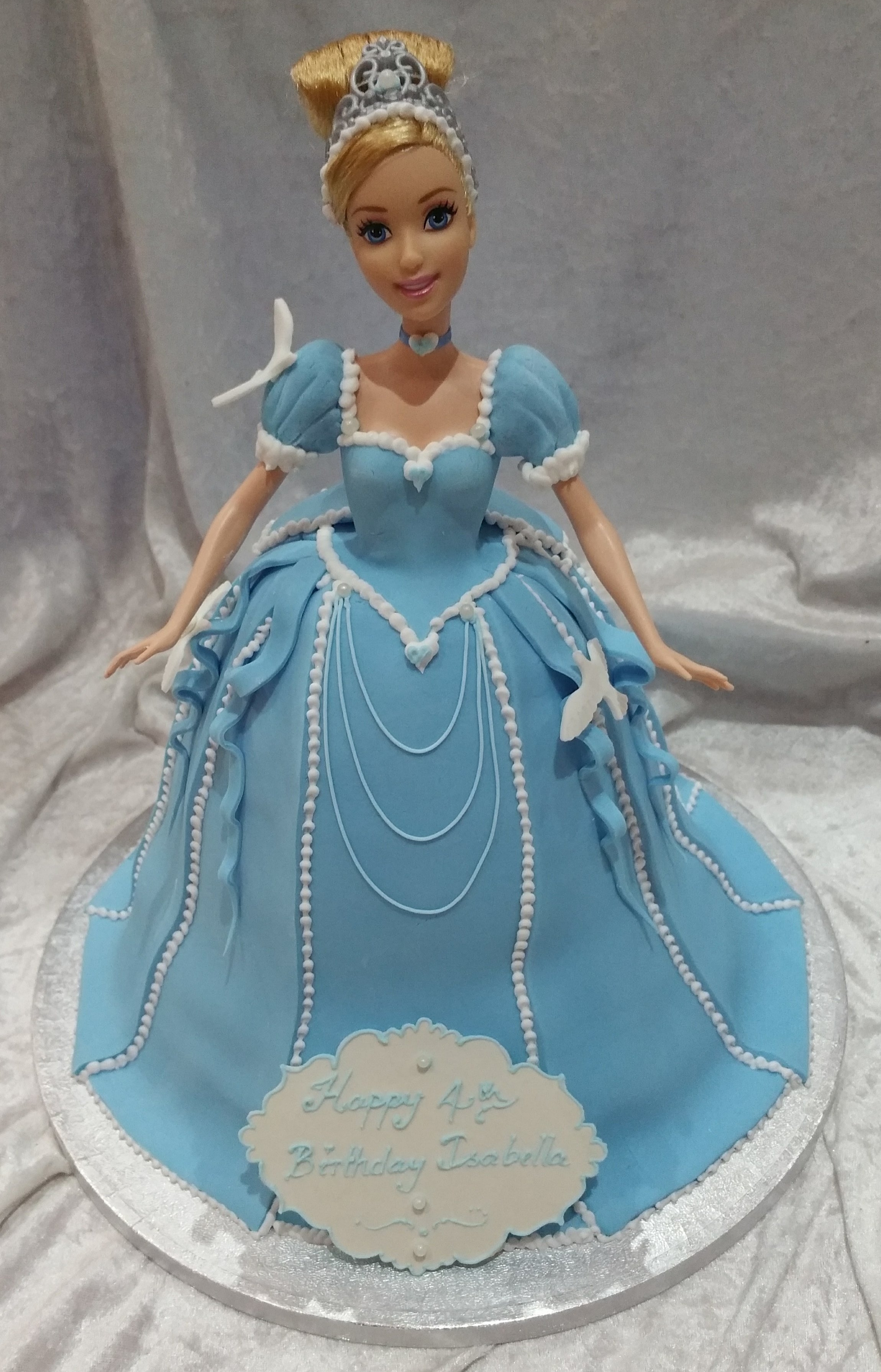 Delicious in the detail - A pretty Cinderella dolly cake for Isabella for her Princess party.  We added plenty of detail in the bows, ribbons and birds to make it as appealing as we could and just right for Cinderella... and Isabella.