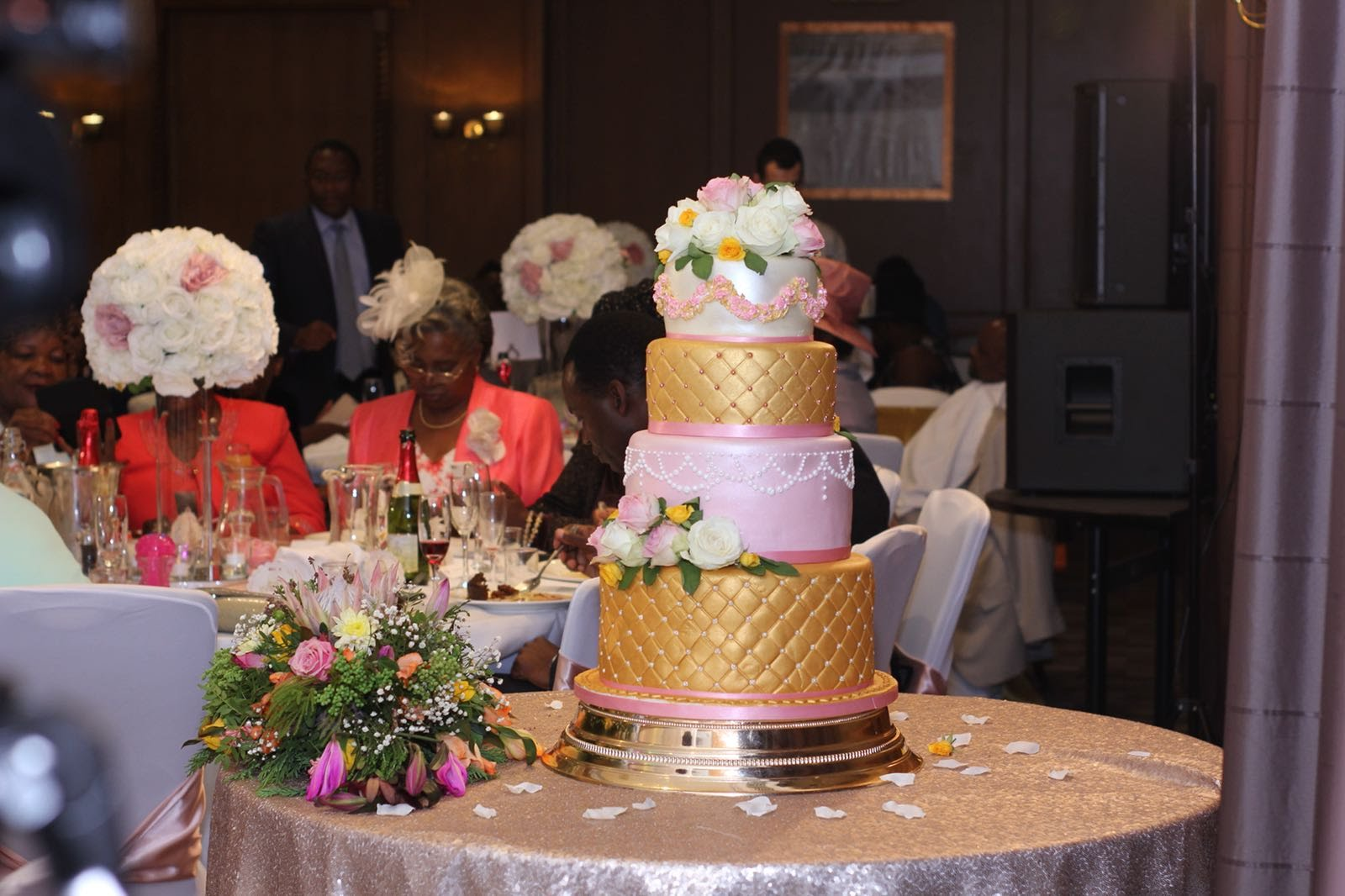 4 tier wedding cake - A beautiful hand painted, hand piped wedding cake made in traditional fruit cake and red velvet cake. A stunning cake enjoyed by all.