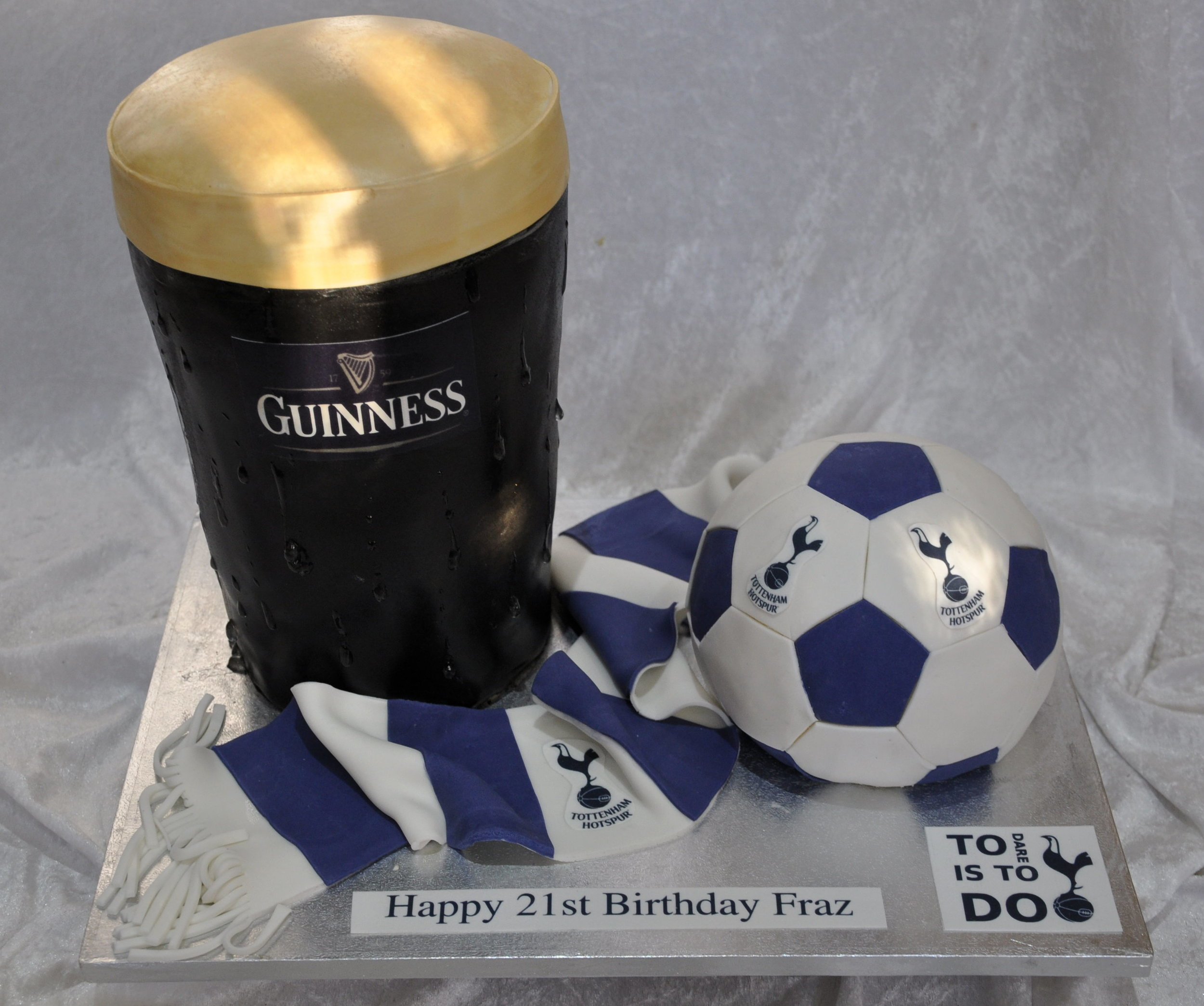 Pint and footy - Super fun over sized standing Guinness glass and footy cake, just right for this young football fan! Delicious in any flavour our Guinness glass is complete with a frothy head and little streams of cold condensation running down the side of the cool glass. So inviting and so tempting, whether the real thing – or as a yummy chocolate marble cake!