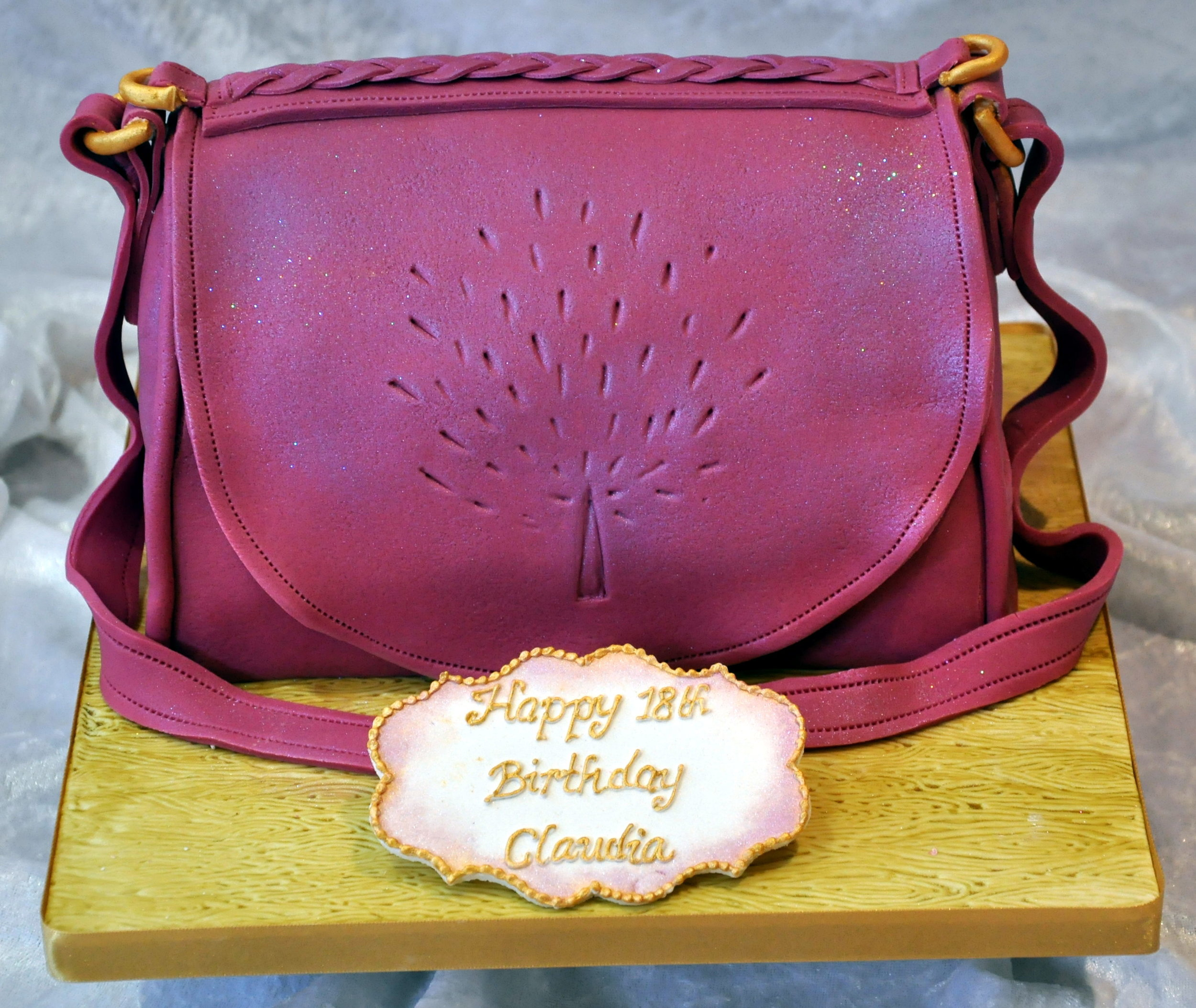 Handbag cake - A wonderfully real Mulberry handbag birthday cake, with leather effect sugarpaste and fine detail. Finished with a personal message.