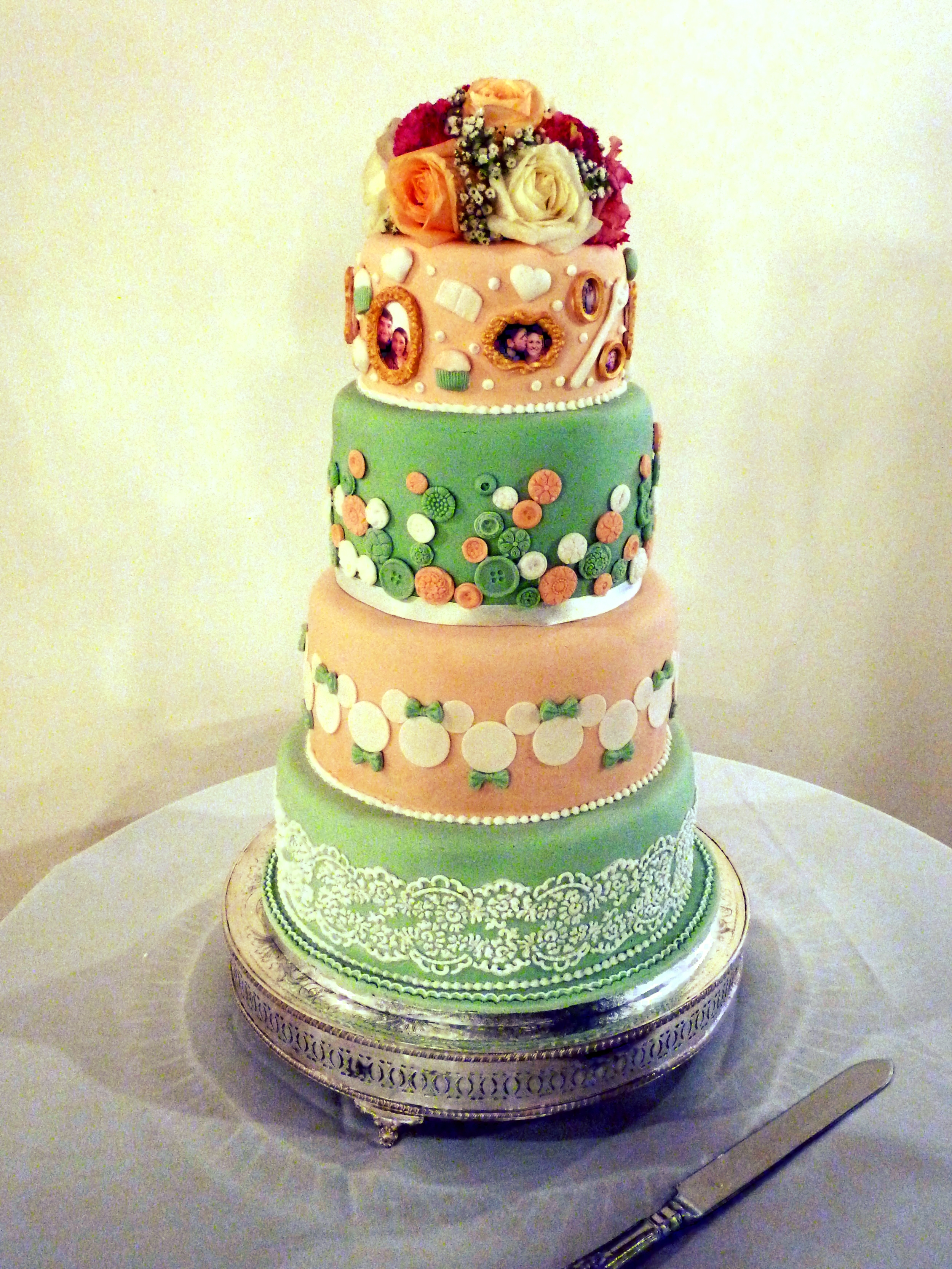 Pretty as a picture - Very personal wedding cake, in 4 tiers, with pictures of the bride and groom, buttons (you are as cute as a button), the bride's career in Disney and hand piped lace to match the bride's dress. Delicious inside too with carrot, vanilla, fruit and chocolate cake.