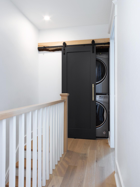 Sliding Door to hide stacked washer dryer