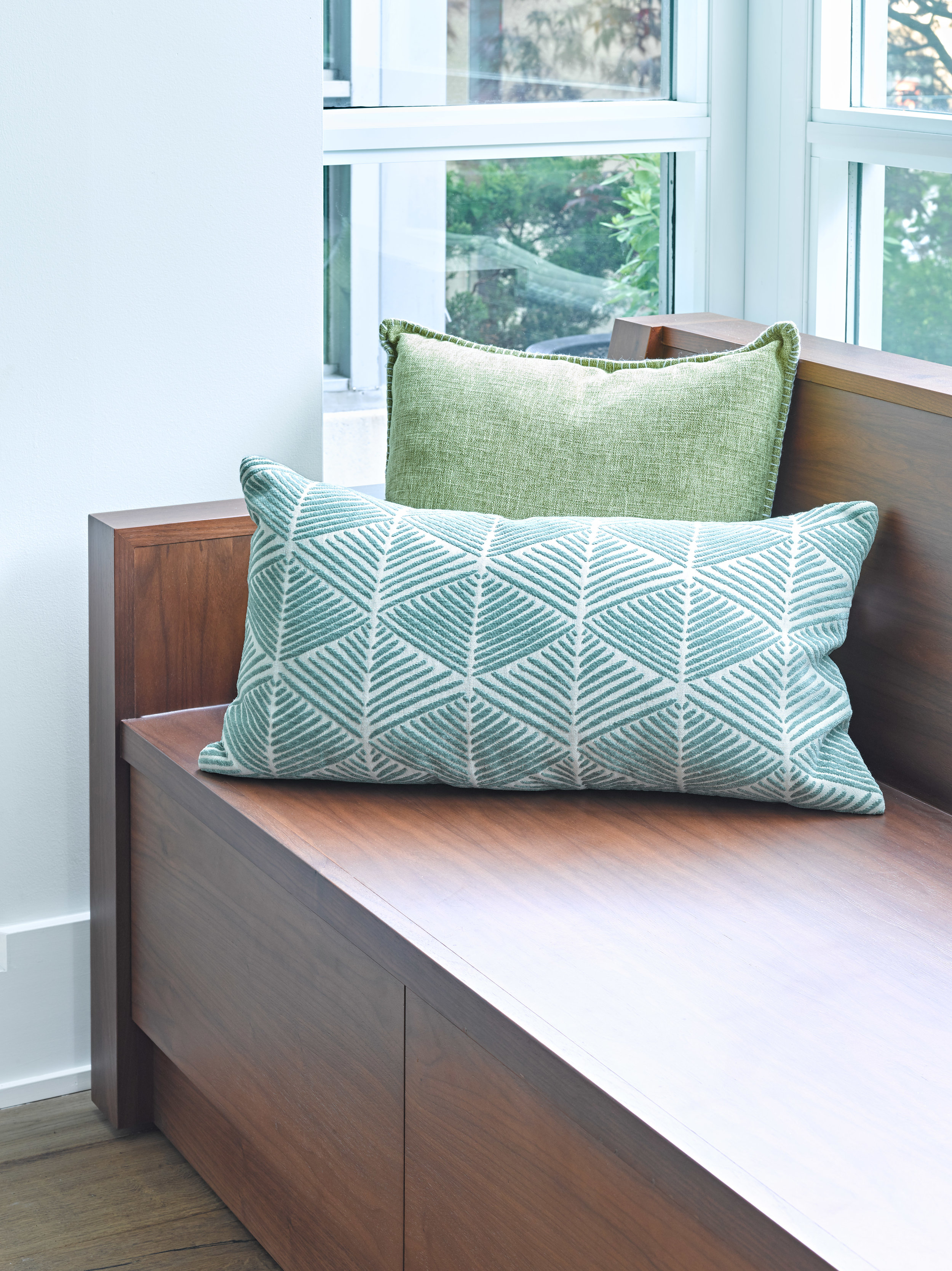 Walnut Bench with Green Pillows