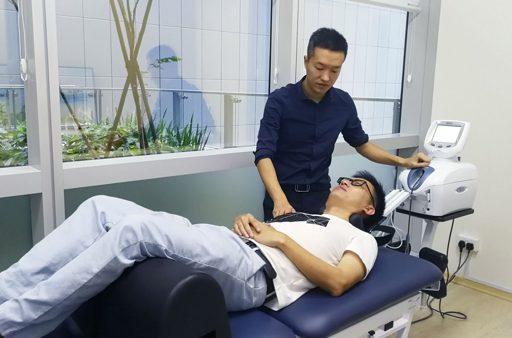 Relieve+your+back+pain+with+the+best+Physiotherapist+in+Singapore.jpg