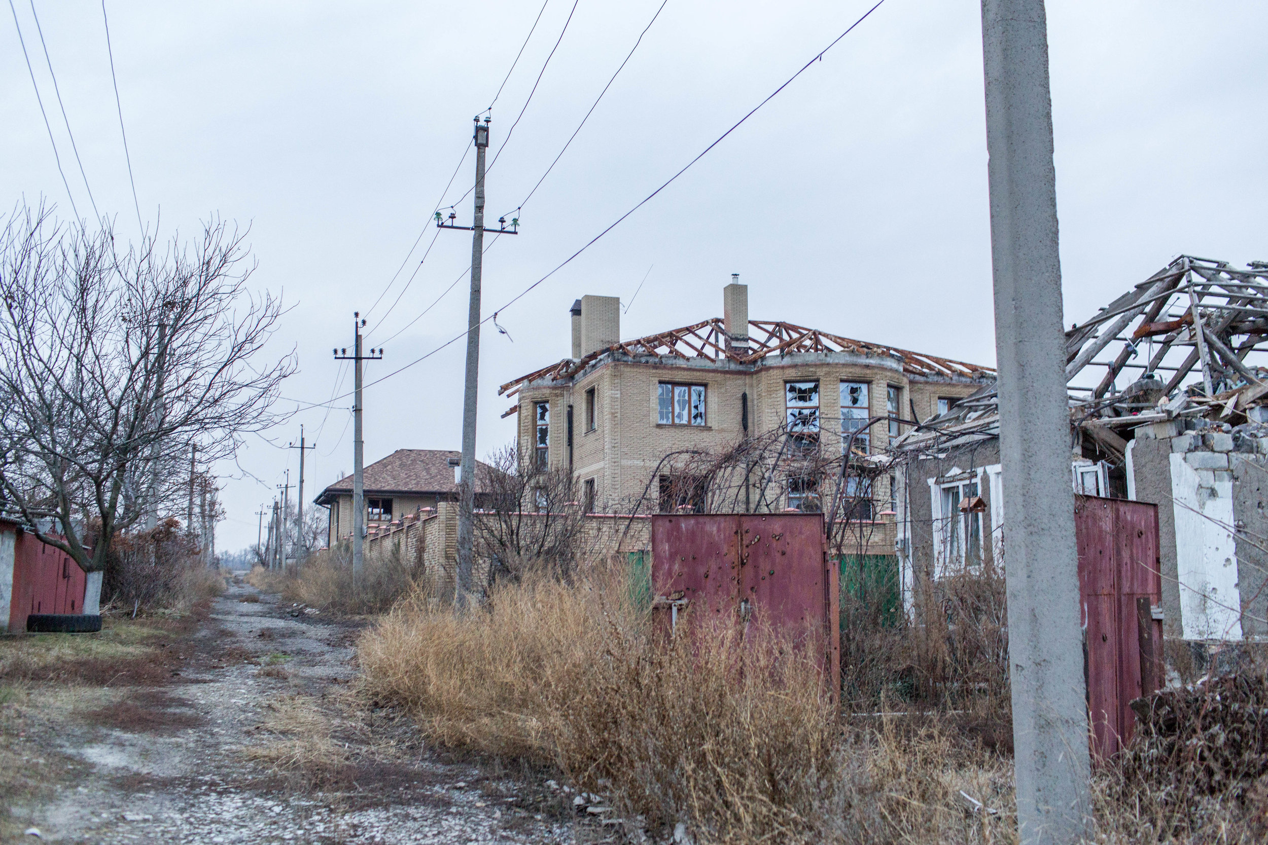 """Pisky was once a summer getaway hotspot, but now lays in ruins. Certain roads are are regularly preyed upon by Separatist snipers hundreds of metres away. I record a conversation between two soldiers; one asks the other how he is, """"Still alive"""", he replies. It's surreal, bittersweet humour, but the most humble representation of a frozen war with no end in sight."""
