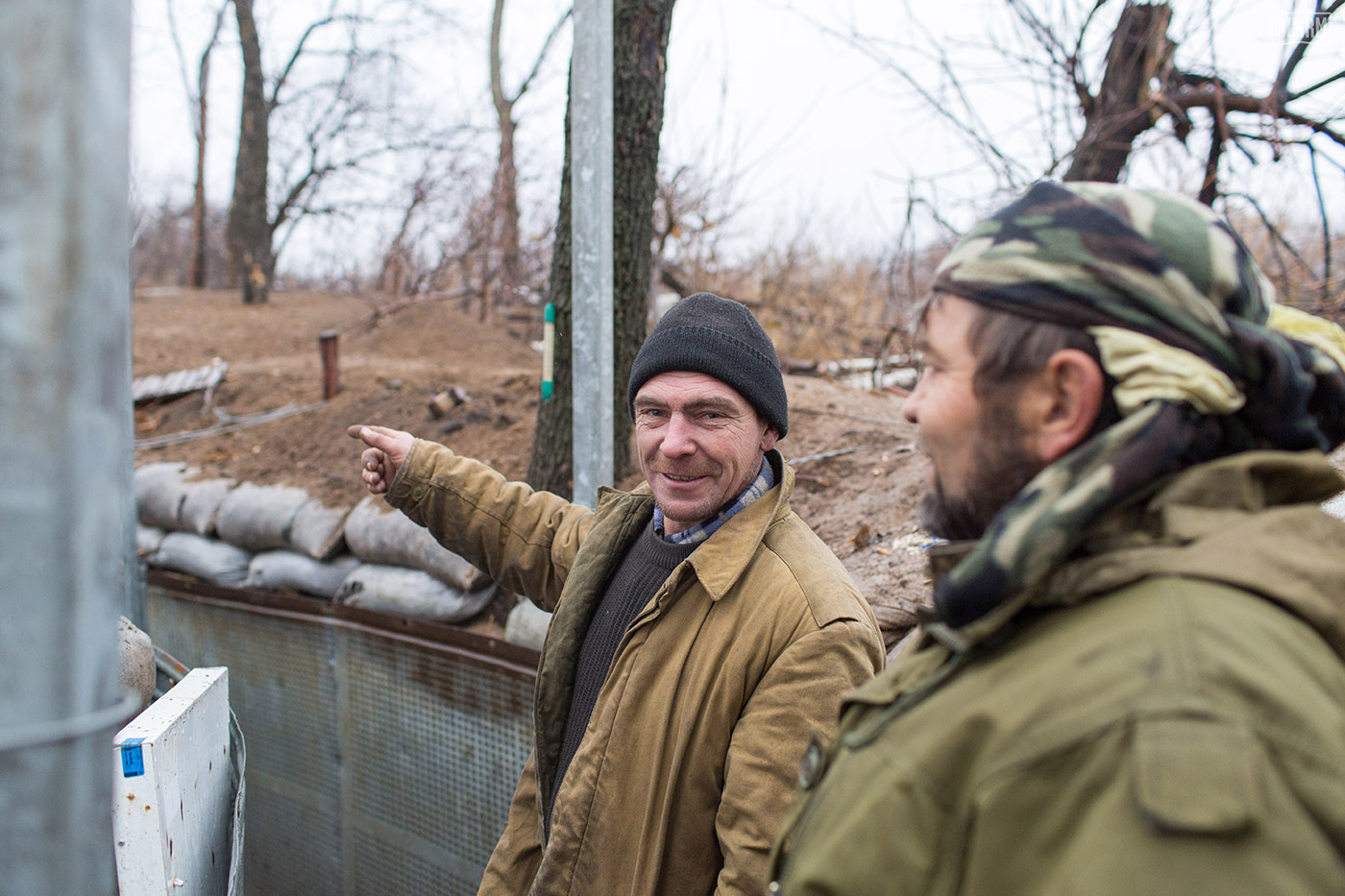 A Ukrainian soldier points further down a trench position. English is not a common language in Ukraine, so we communicated with pointing, gestures, and laughter.