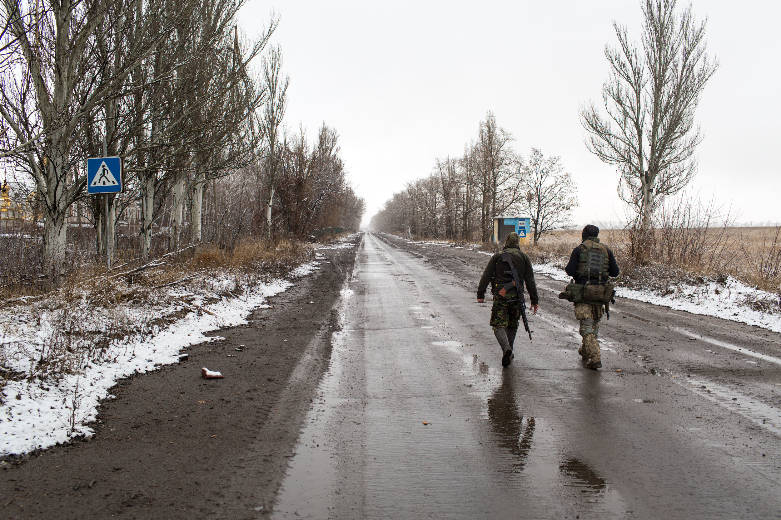 The main road into Pisky, a village that held significant geographical advantage to Ukrainian strategies throughout the entirety of the battle for Donetsk Oblast. Military vehicles ferry supplies in and out along this road, as well as provide emergency medical support for soldiers wounded in conflict. Since beginning nearly two years ago, The War in Eastern Ukraine has claimed the lives of over 8,000 military personnel and civilians.