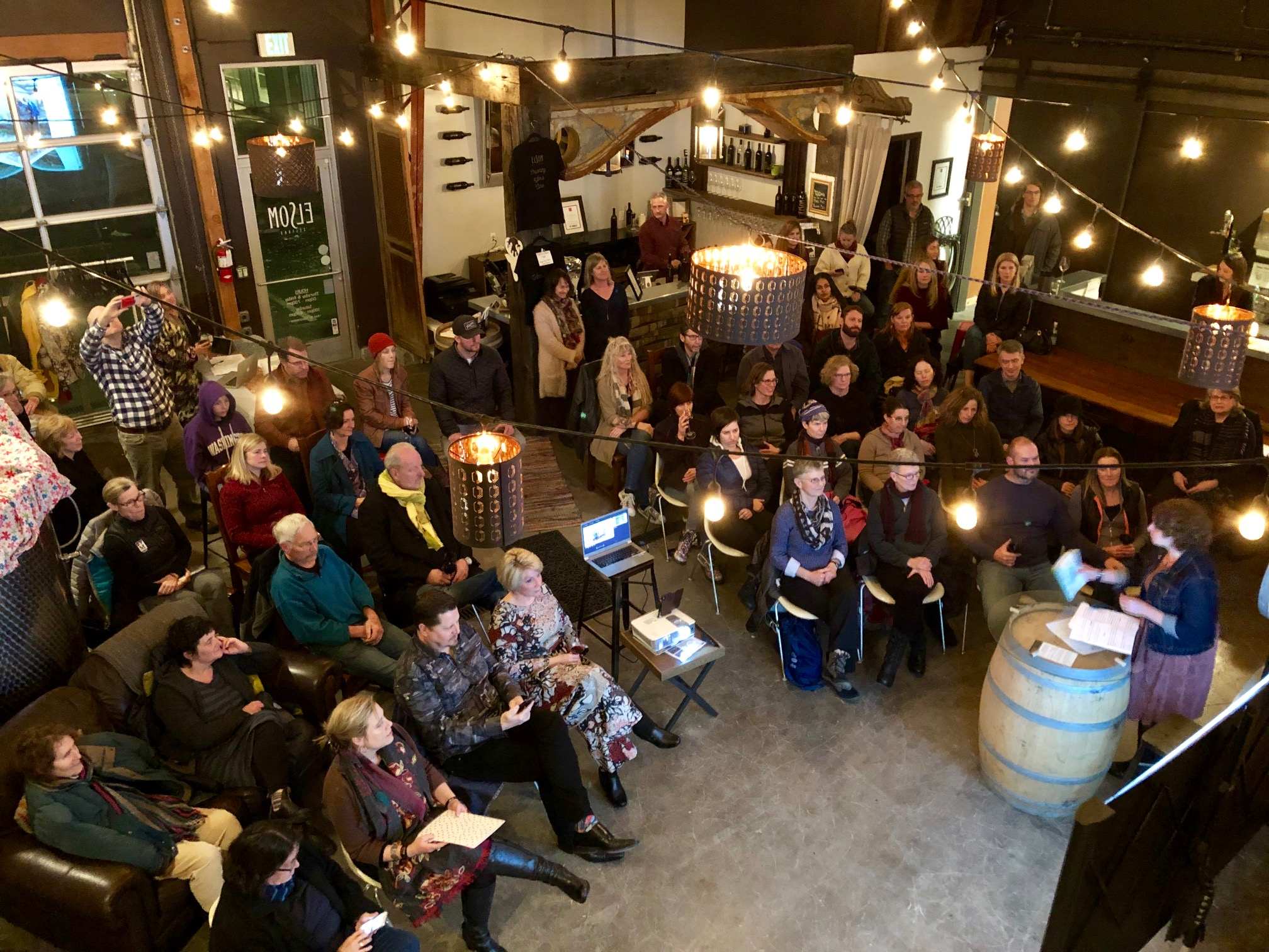 Travelers listening intently to Beth Jusino at Adventure Uncorked at the Adventure Hub & Winery on February 7, 2019. Hosted by Explorer X.