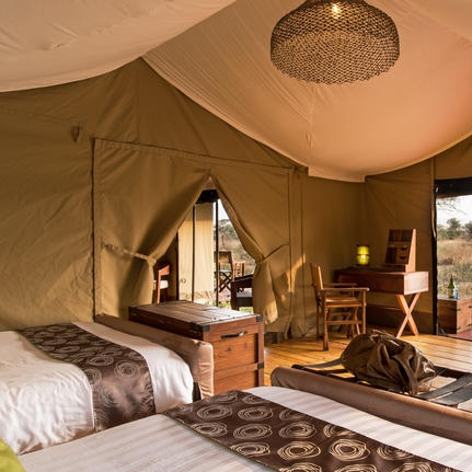 Lemala Ewanjan Tented Camp | Central Serengeti - Lemala Ewanjan is an authentic intimate tented camp set in a secluded part of the game-rich Seronera Valley in Central Serengeti and is renknowned for its year-round game viewing due to its abundance of water in the many rivers, as well as for its large populations of resident big cats. Each tent is fitted with two queen-size beds with warm duvets, a flush toilet, large safari-style shower, plentiful running water, wooden storage cabinets and flooring, 24-hour solar lighting and outside loungers from which to enjoy early morning teas and coffees and refreshing afternoon gin and tonics.