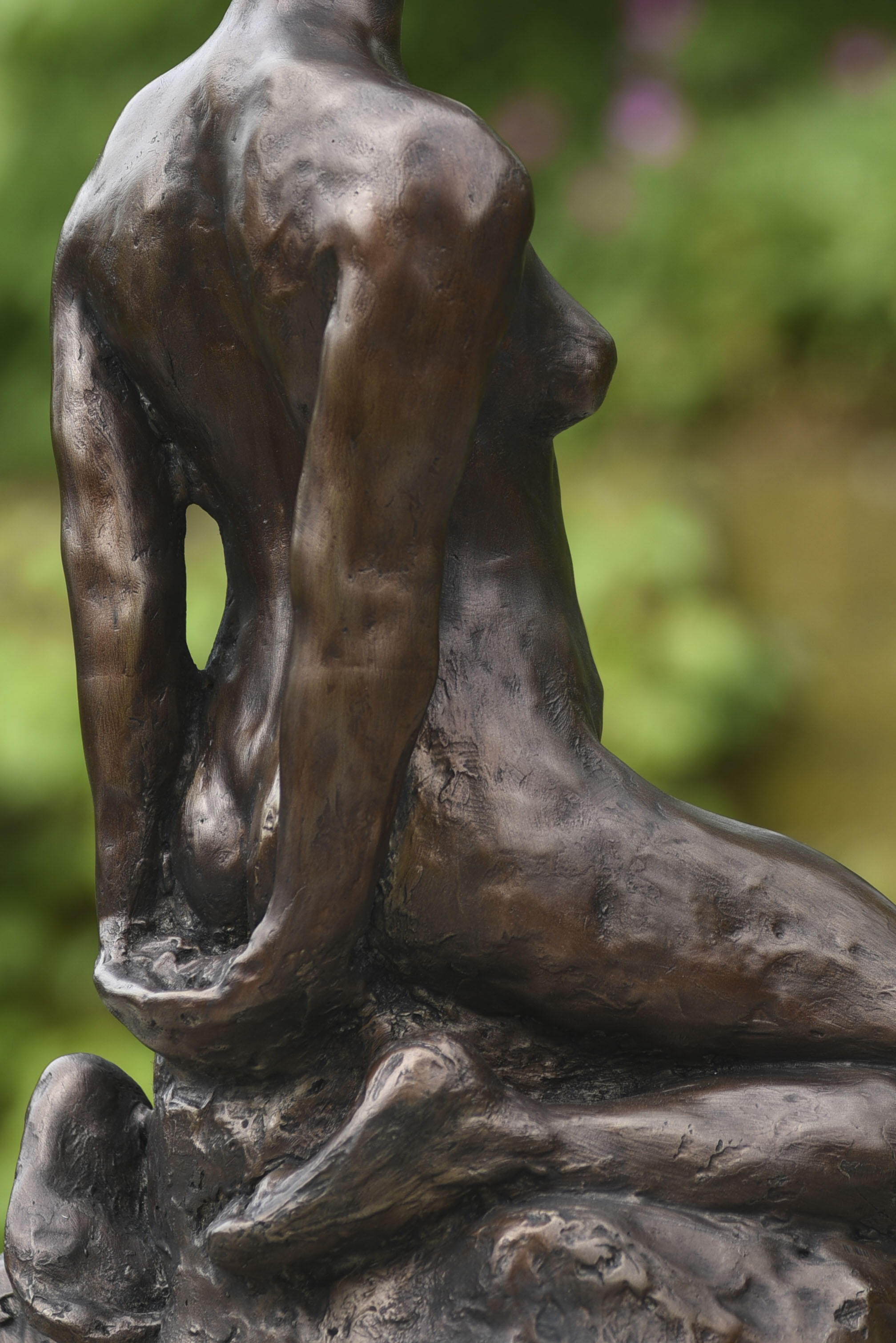Close up of back view of statue showing patina.jpg