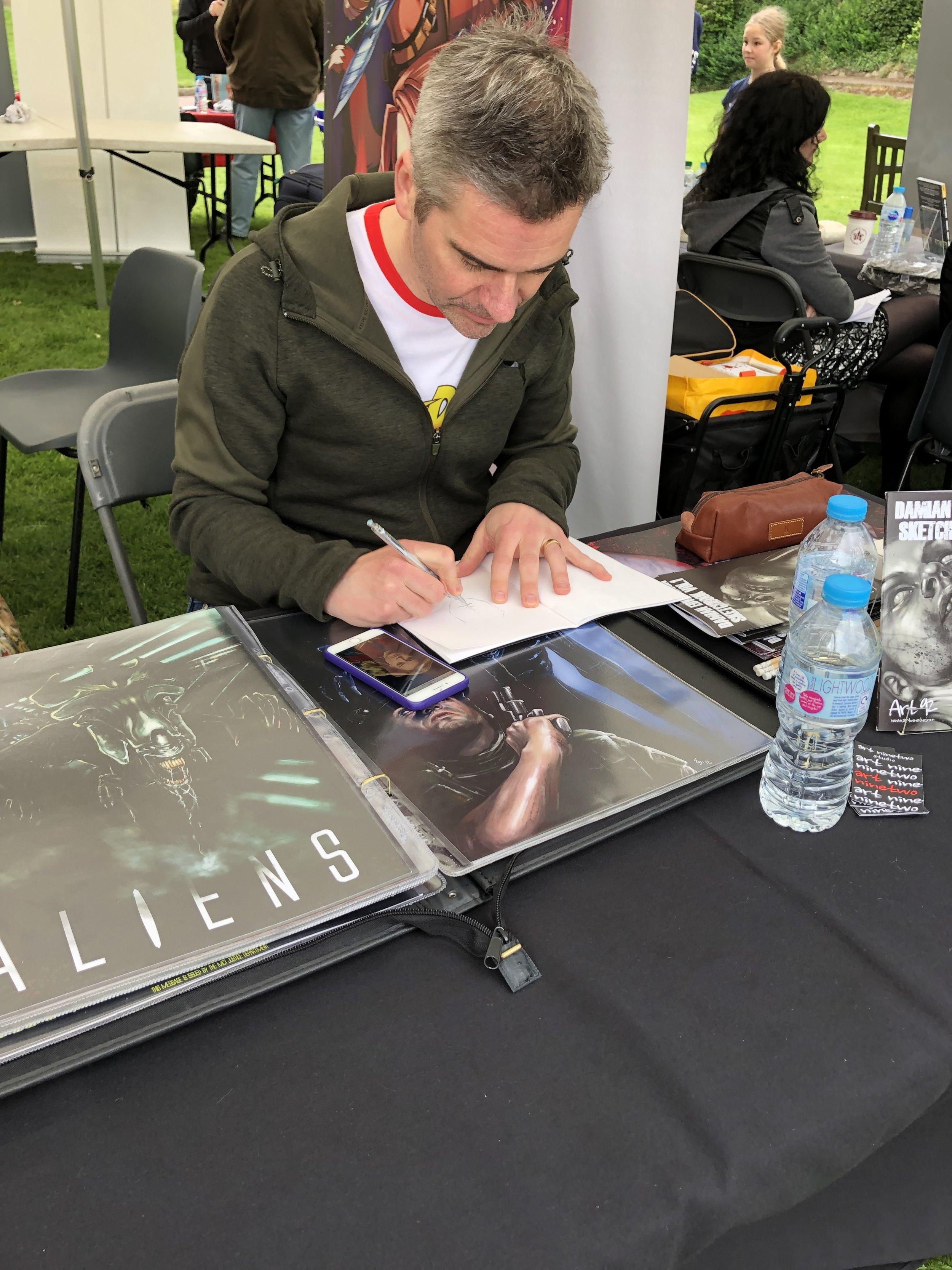 Damian sketching