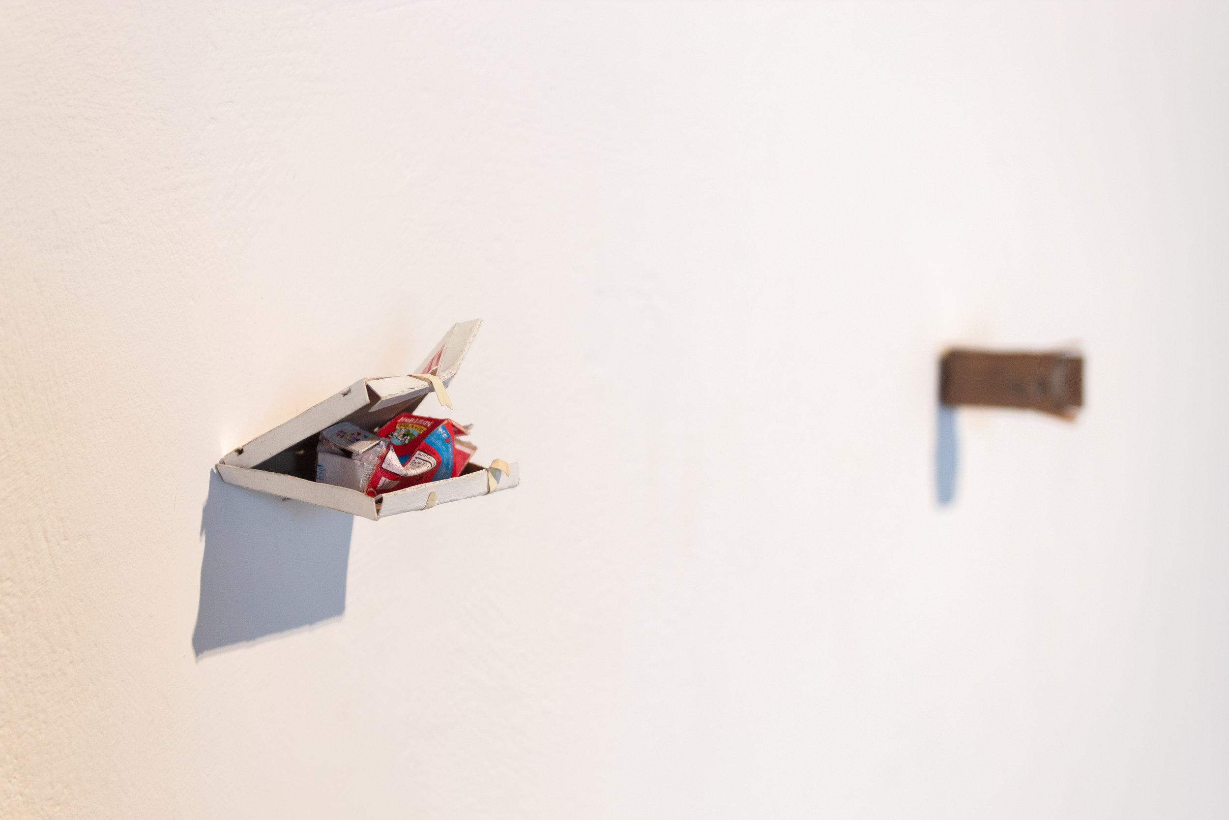 Installation view, Rachel Grobstein,  Pizza Box and Milk  (2017).