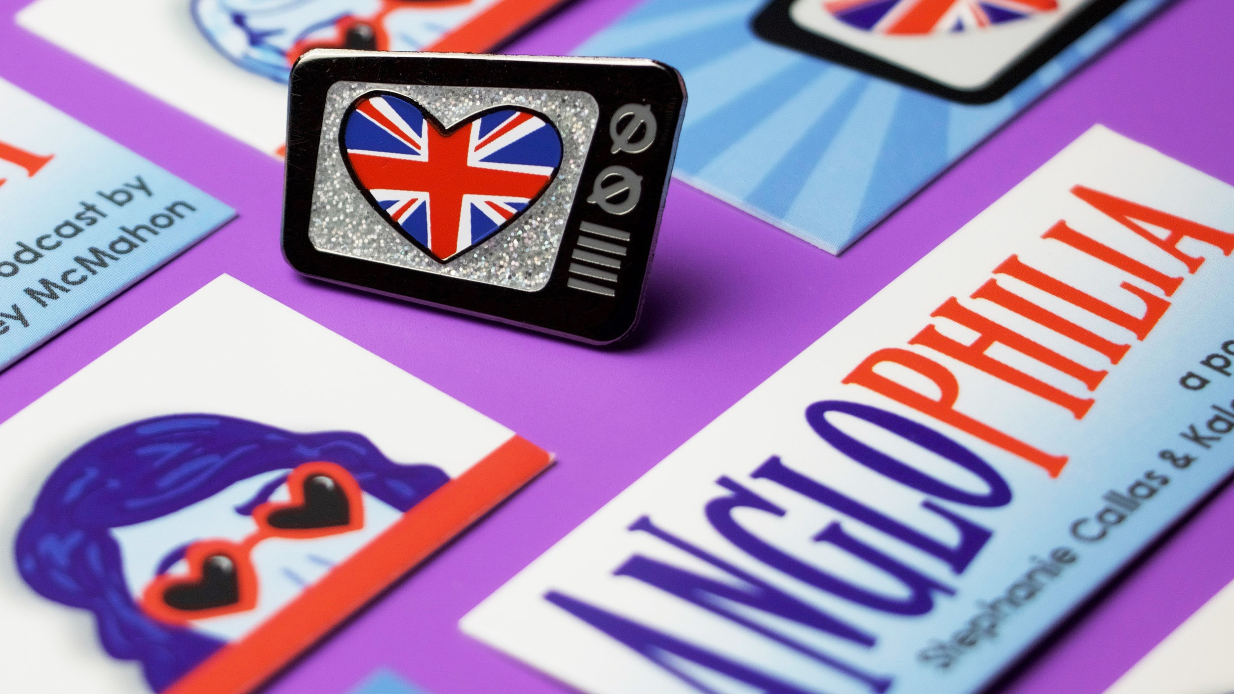Merchandise - Rep your favorite BritCom podcast with our super official, completely original pins, brought to you by JamaHartArt.