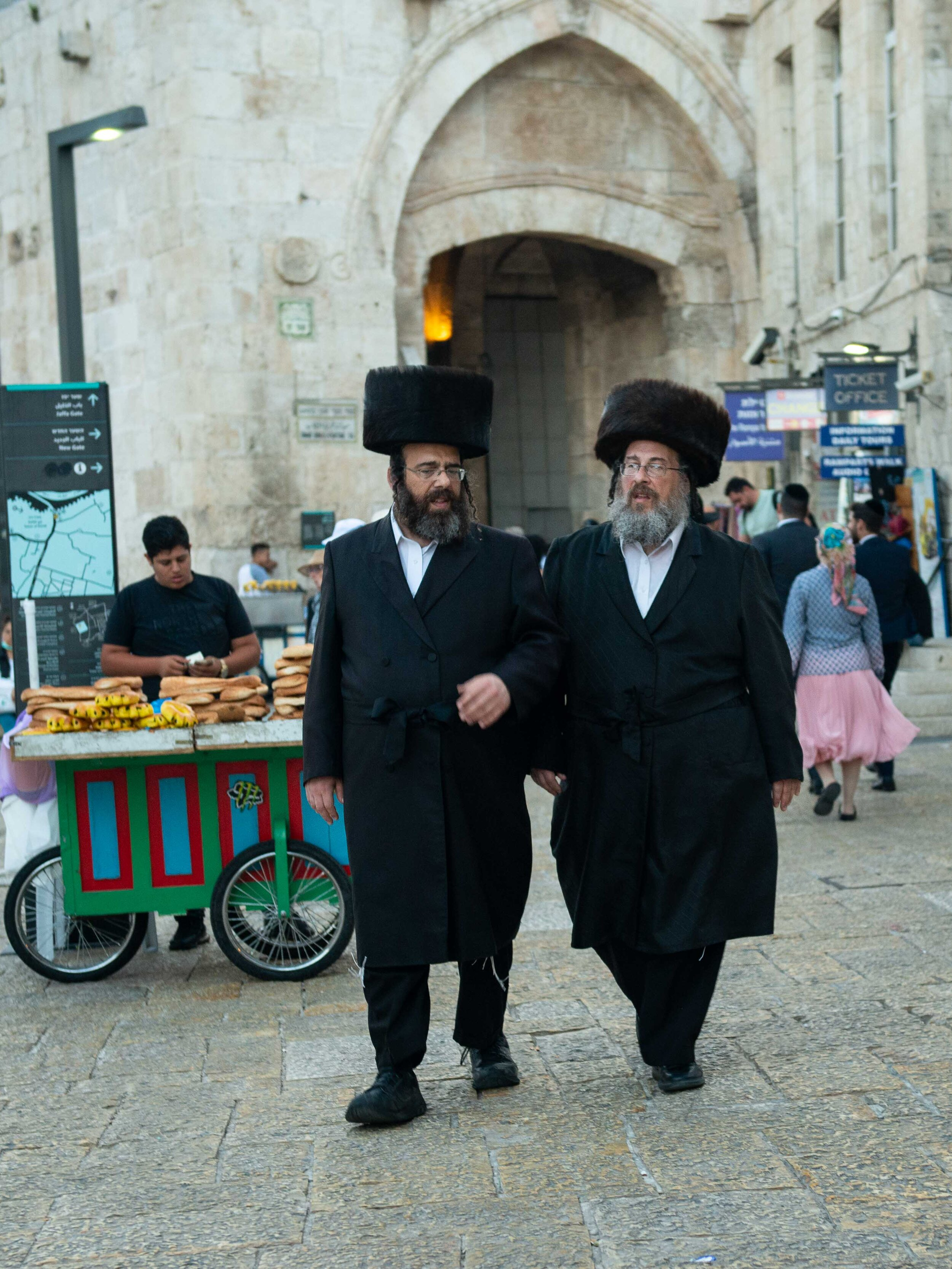Haredi Jewish men walking through Jaffa Gate into the Old City, Jerusalem