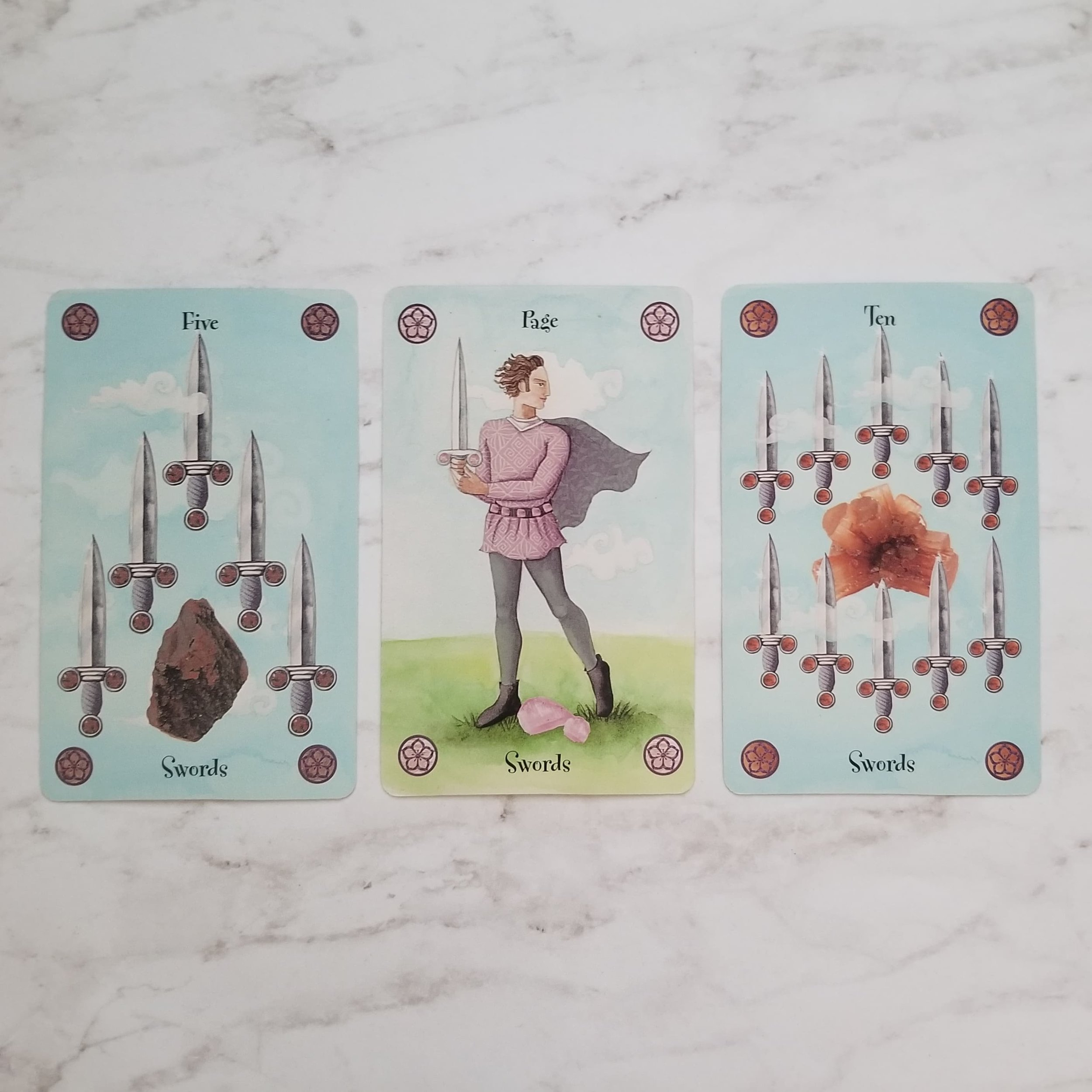 From left to right: Five of Swords, Page of Swords, Ten of Swords