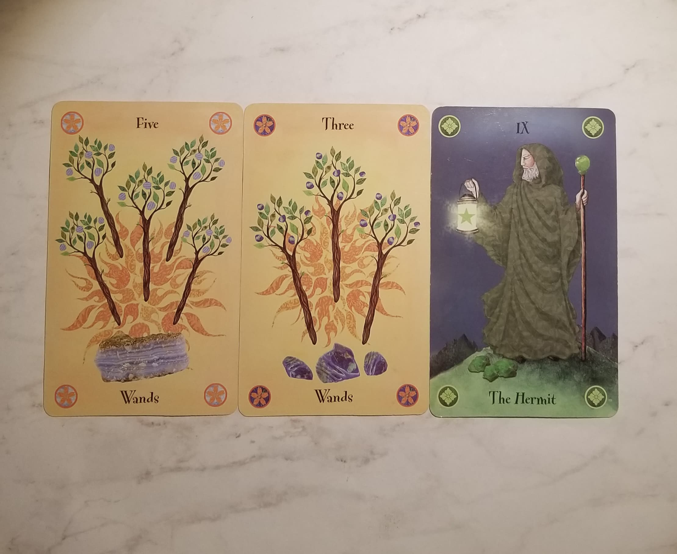 From Left to Right: Five of Wands, Three of Wands, The Hermit