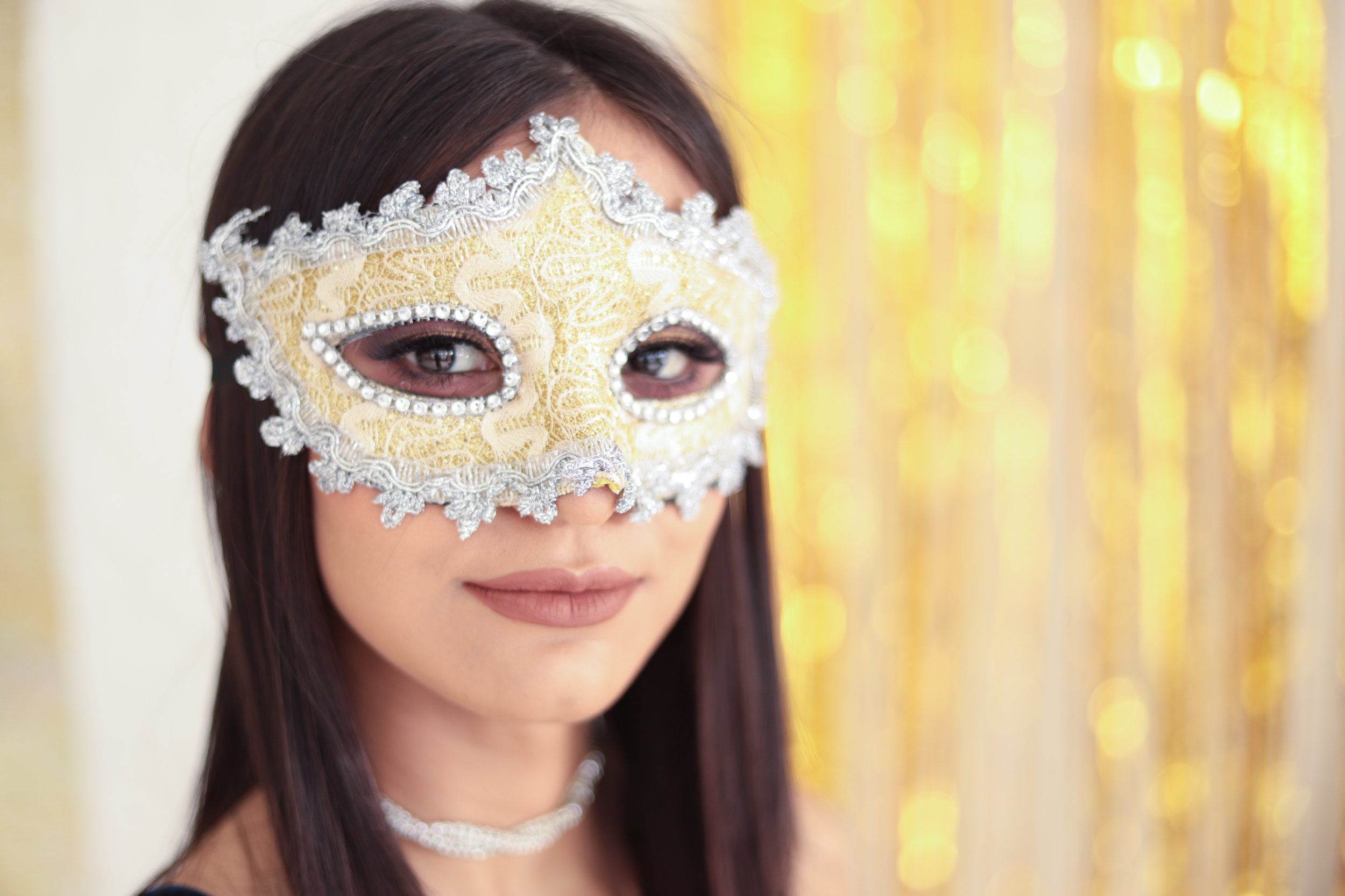 Woman in gold mardi gras mask